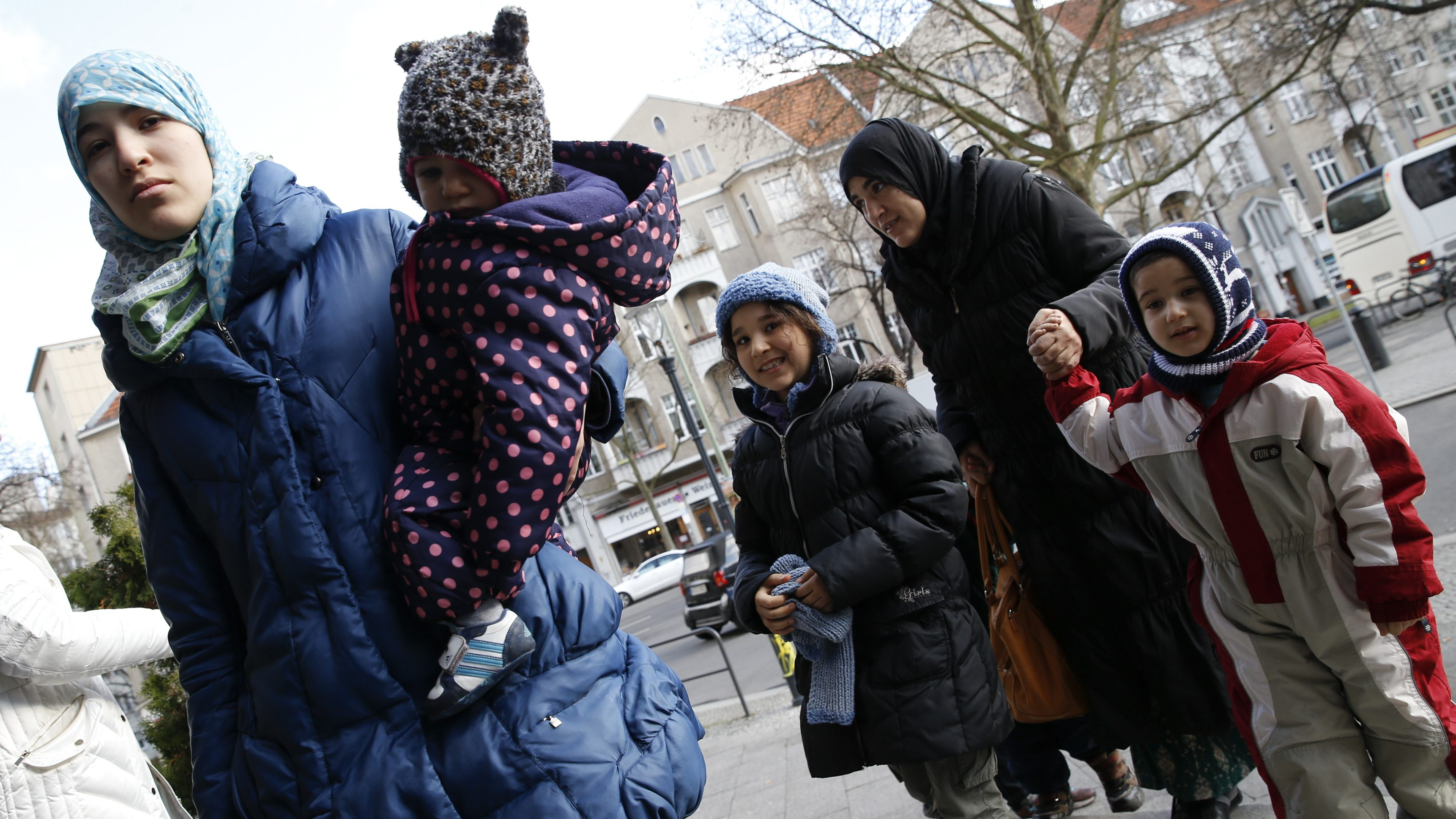 Migrants arrive at a refugee shelter in Berlin