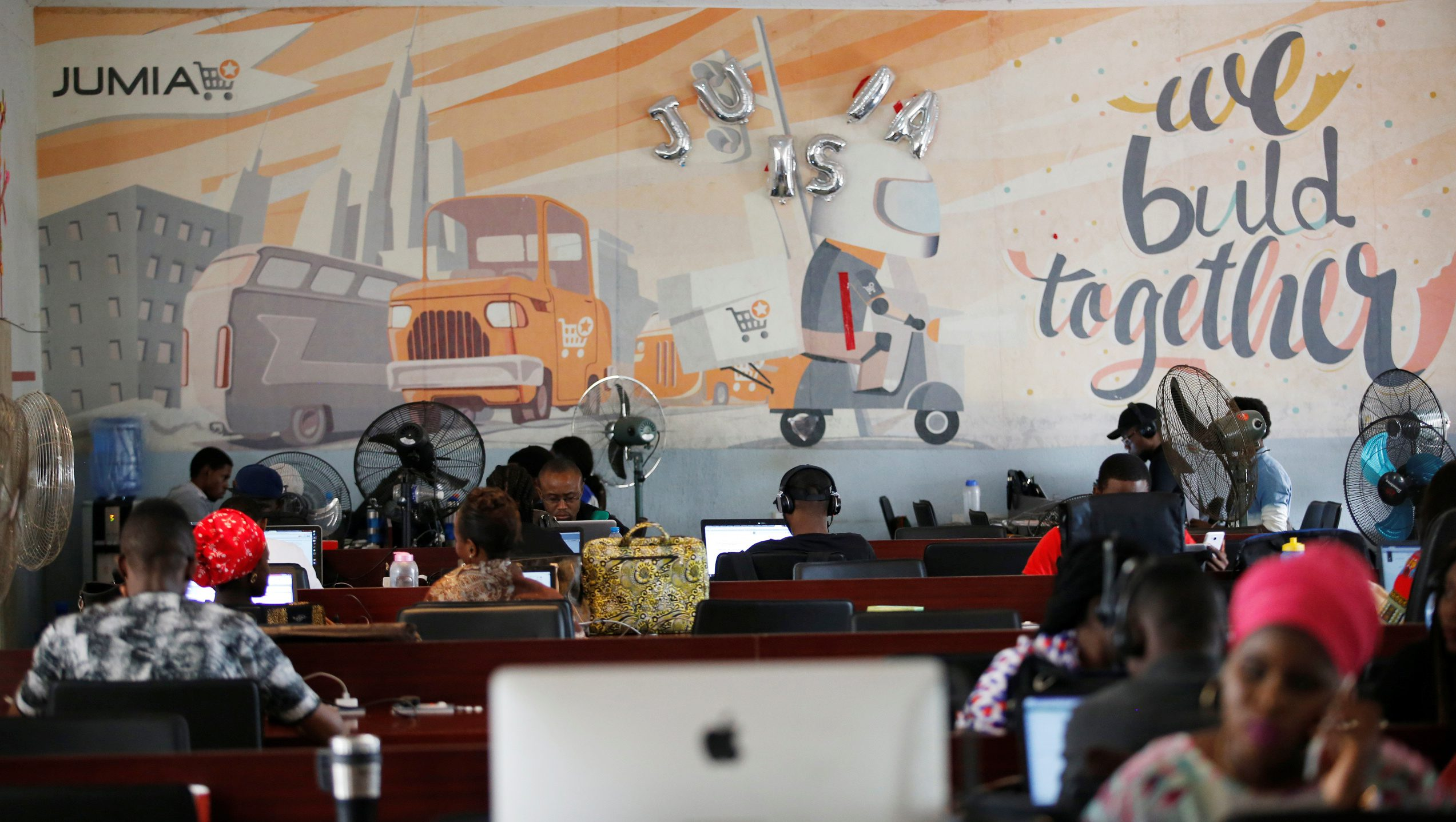 People work on computers at the online store Jumia in Ikeja district, in Nigeria's commercial capital Lagos June 10, 2016.