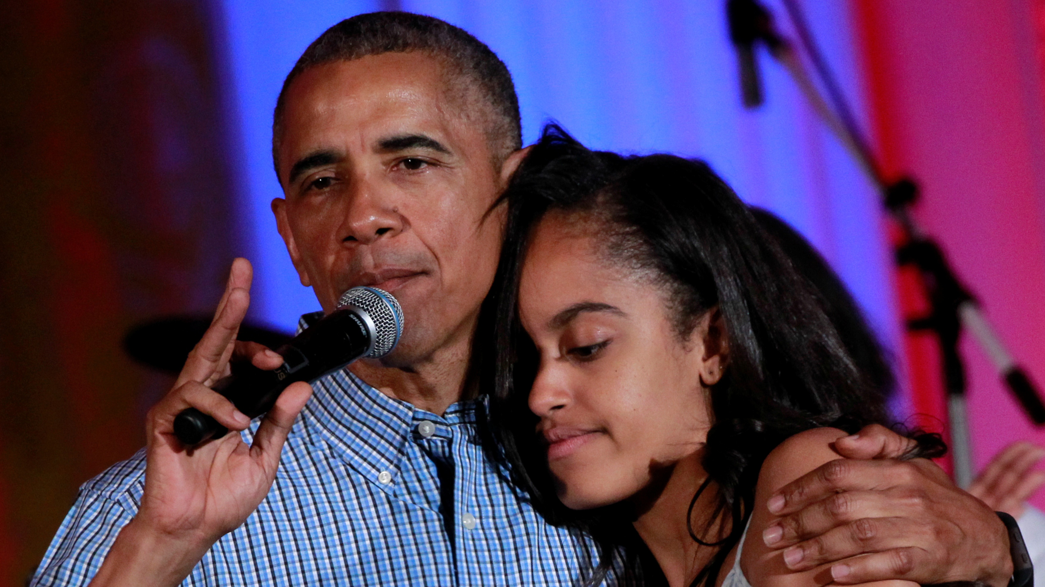 U.S. President Barack Obama congratulates his daughter Malia on her birthday during the Independence Day celebration at the White House in Washington U.S., July 4, 2016. REUTERS/Yuri Gripas