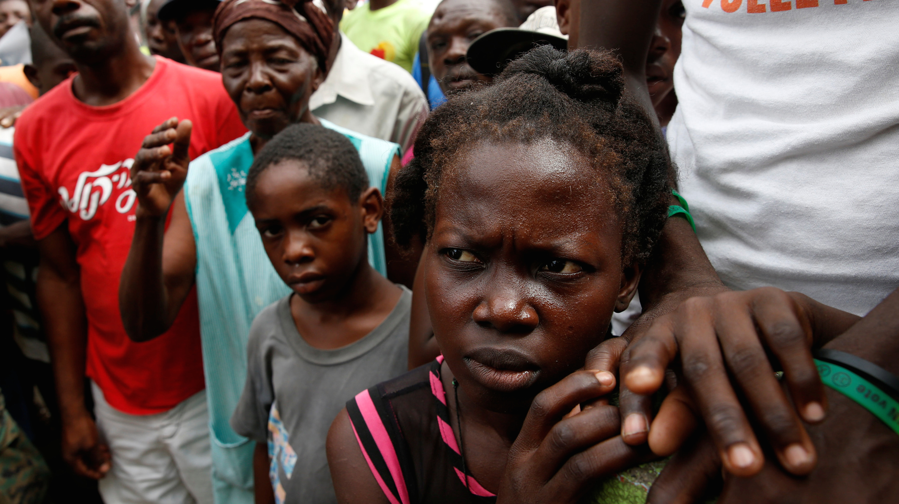 People wait for food to be handed out after Hurricane Matthew hit Jeremie, Haiti, October 18, 2016.