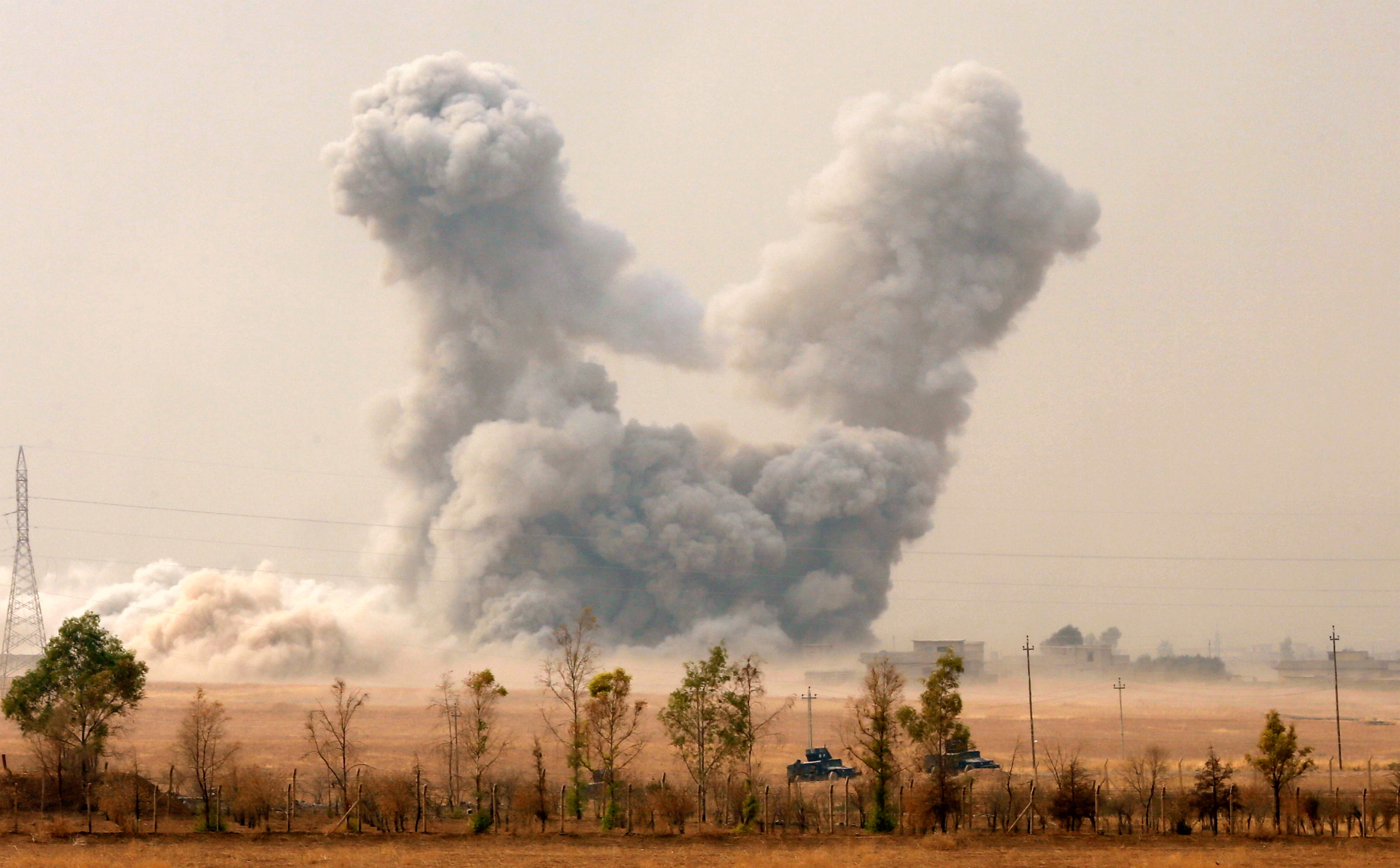 Smoke rises after an U.S. airstrike, while the Iraqi army pushes into Topzawa village during the operation against Islamic State militants near Bashiqa
