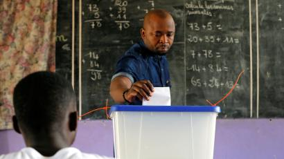 A man casts his vote at a polling station during the legislative elections in Abidjan, Ivory Coast December 18, 2016.