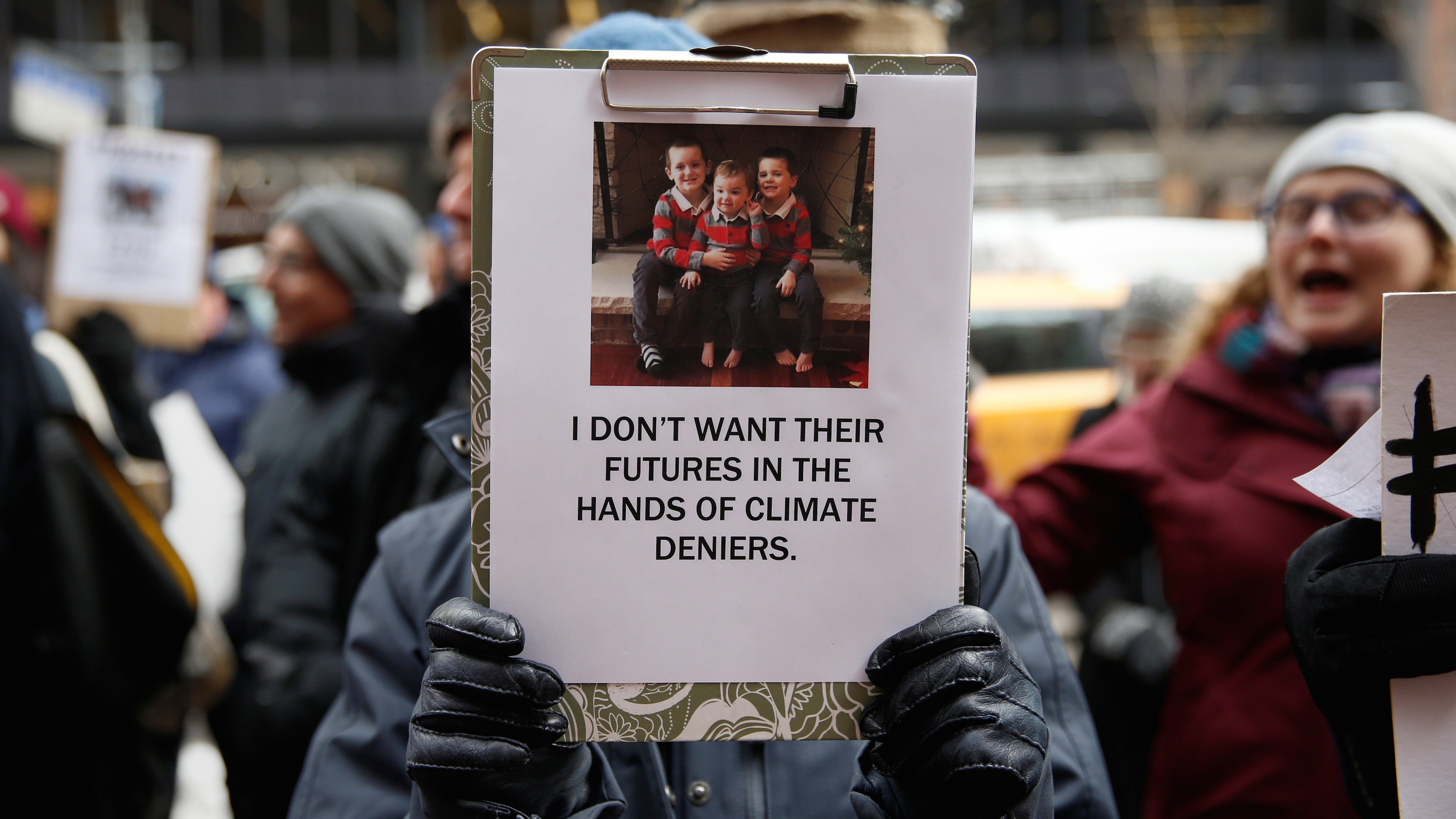 Demonstrators gather protesting climate change outside the office of U.S. Senator Charles Schumer (D-NY) in New York, U.S., January 9, 2017.