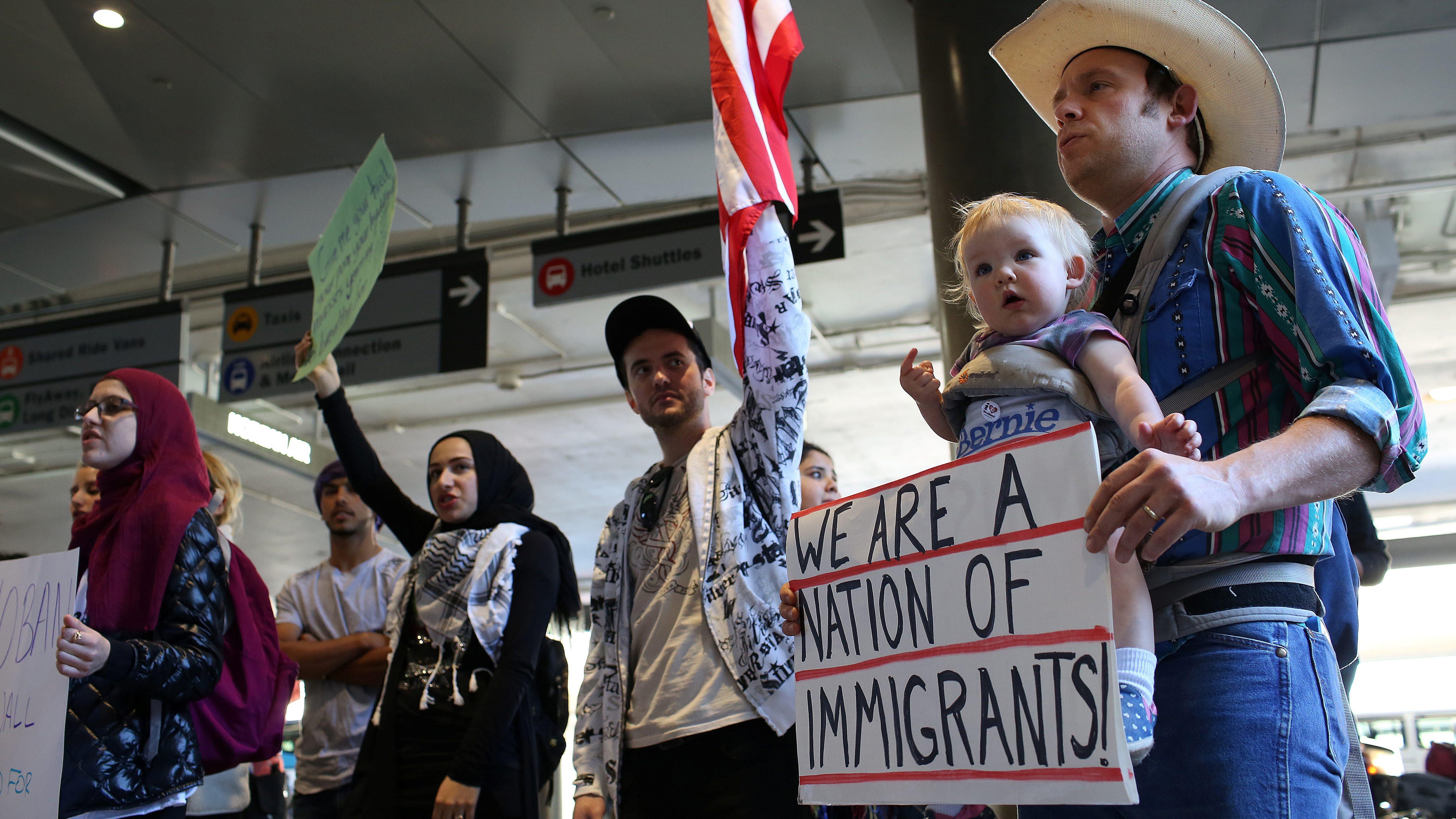 People gather to protest against U.S. President Donald Trump's executive order travel ban at Los Angeles International Airport (LAX), California, U.S. January 31, 2017. REUTERS/Monica Almeida - RTX2Z2ZH