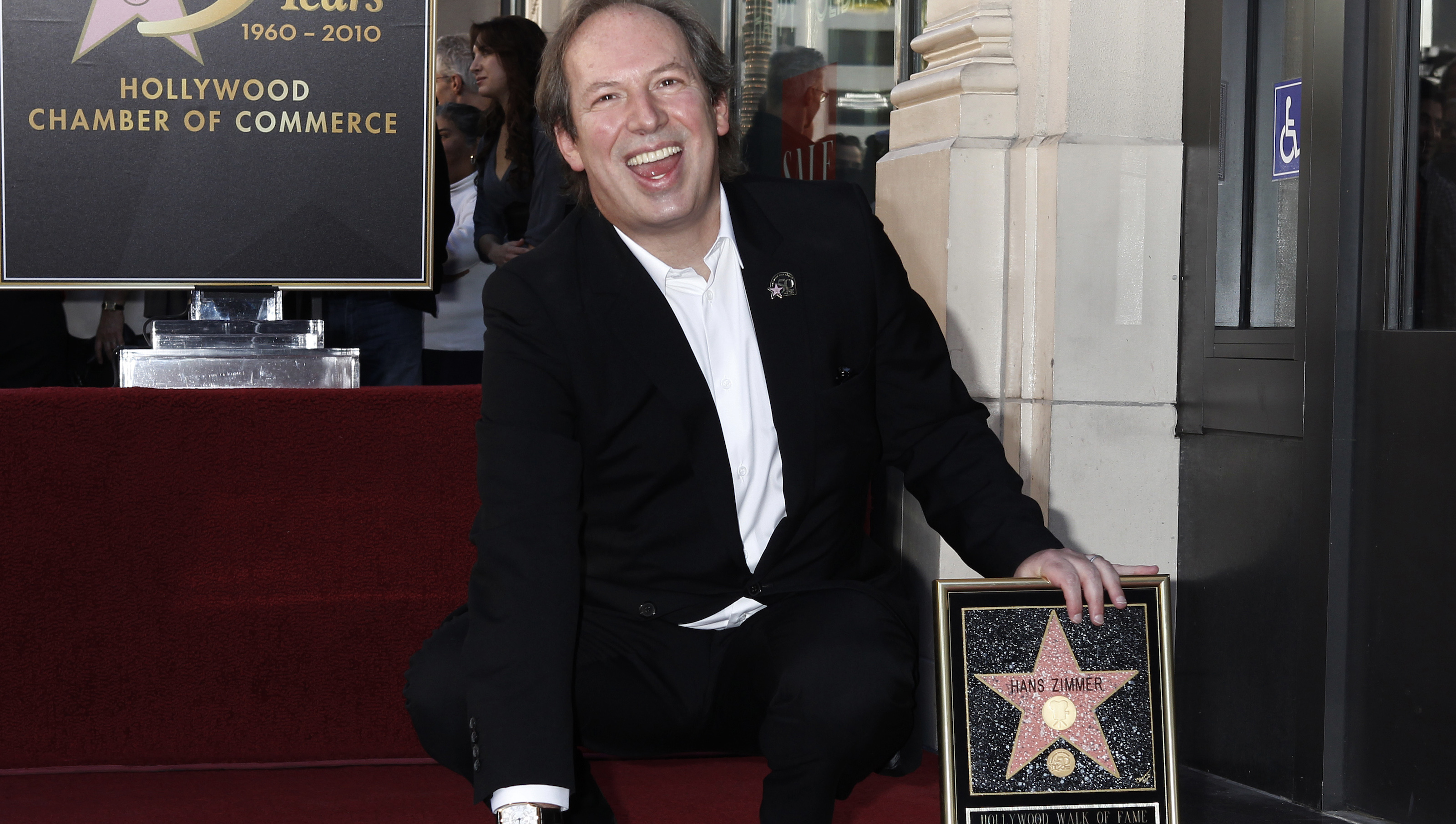 Academy Award winning German-born composer Hans Zimmer touches his newly unveiled star on the Hollywood Walk of Fame in Hollywood December 8, 2010.  REUTERS/Fred Prouser (UNITED STATES - Tags: ENTERTAINMENT) - RTXVJKR