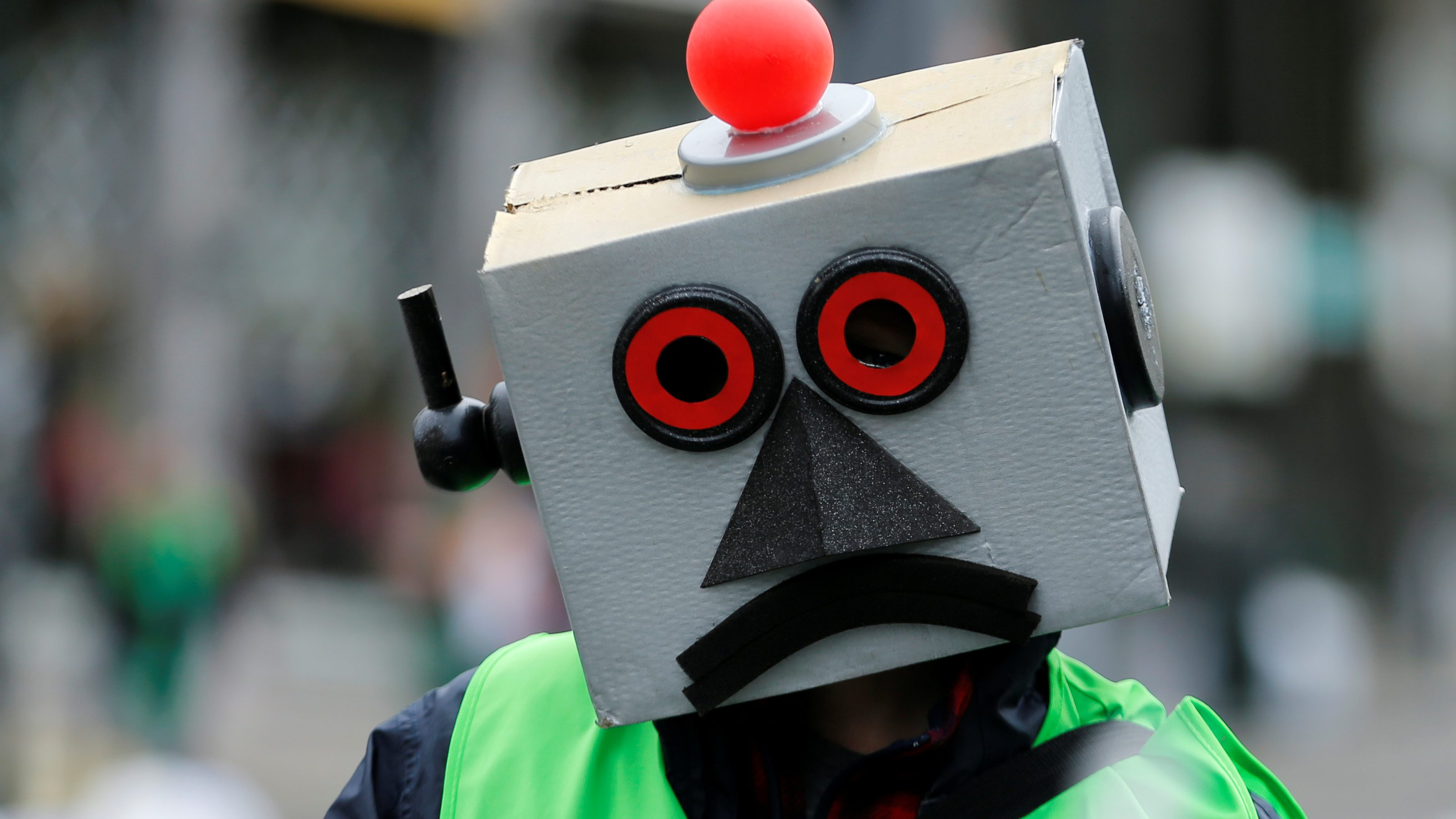 A protester dressed as a robot takes part in a march by Belgian public sector workers in central Brussels, Belgium, May 31, 2016.
