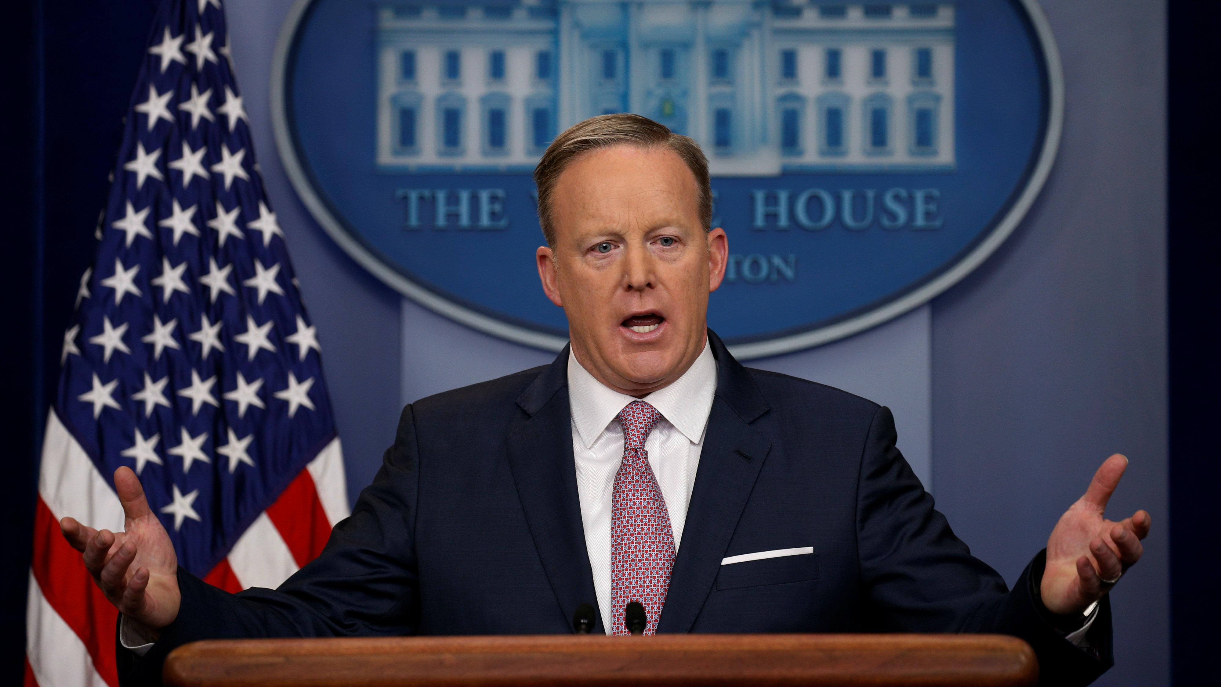 White House Press Secretary Sean Spicer at a podium.