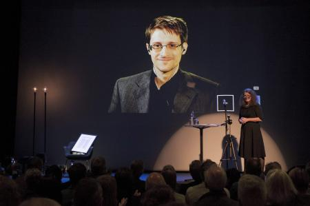 A chair is pictured on stage as former U.S. National Security Agency contractor Edward Snowden is awarded the Bjornson prize in Molde, Norway September 5, 2015. The Norwegian cultural academy awarded the Bjornson prize to Snowden as part of a larger seminar where the main topic is dedicated to the right of privacy, surveillance and monitoring. Pictured right is Hege Newth Nouri, president of the Bjornson Academy.