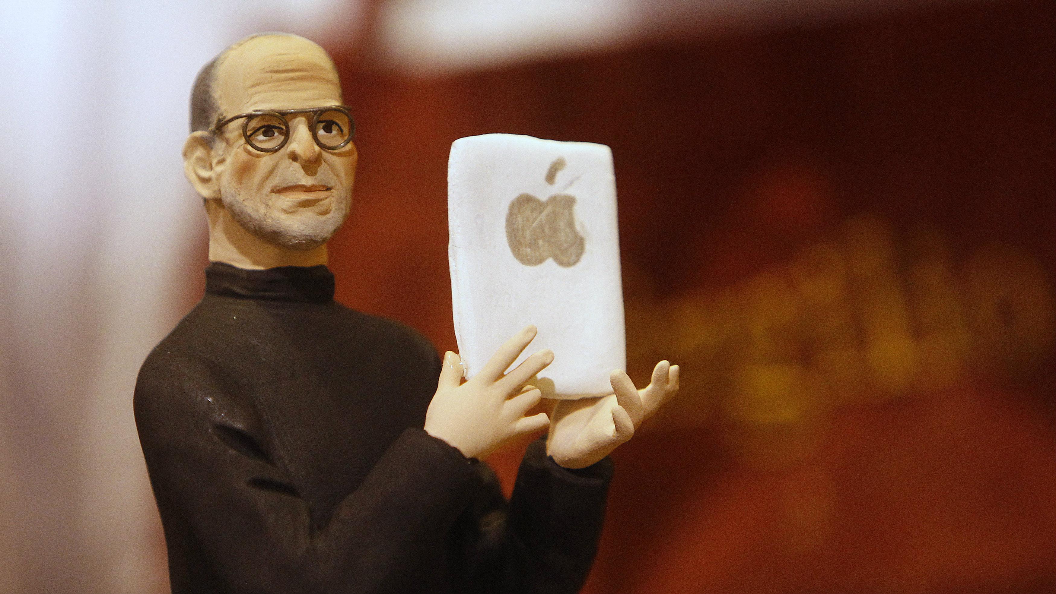 A figure of Apple founder Steve Jobs is seen in an craft shop in Naples October 7, 2011. REUTERS/Ciro De Luca