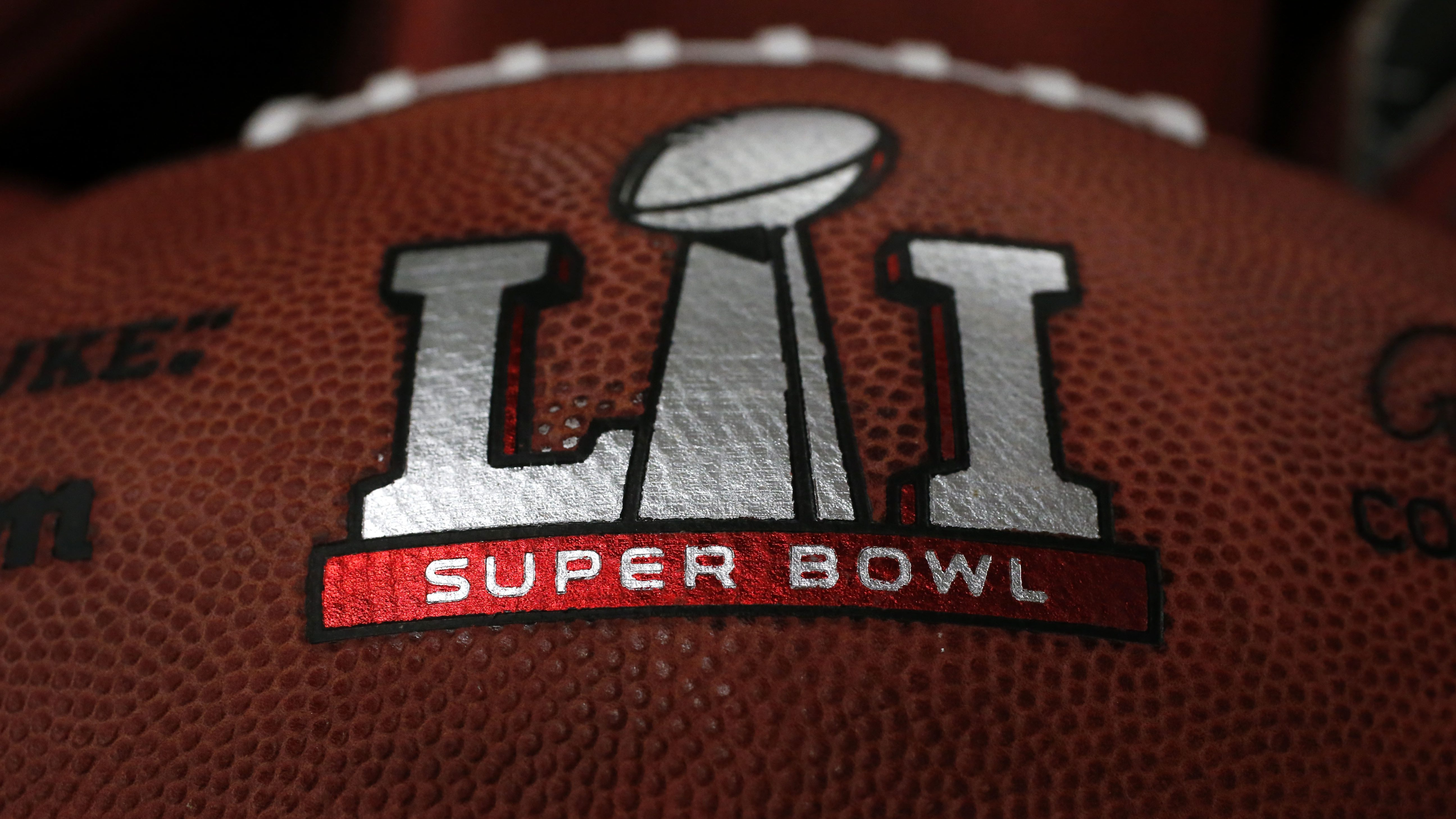 The first NFL Super Bowl LI football sits in a bin with other balls to be stamped with the New England Patriots and Atlanta Falcons names at the Wilson Sporting Goods factory Sunday, Jan. 22, 2017, in Ada, Ohio. (AP Photo/Charles Rex Arbogast)