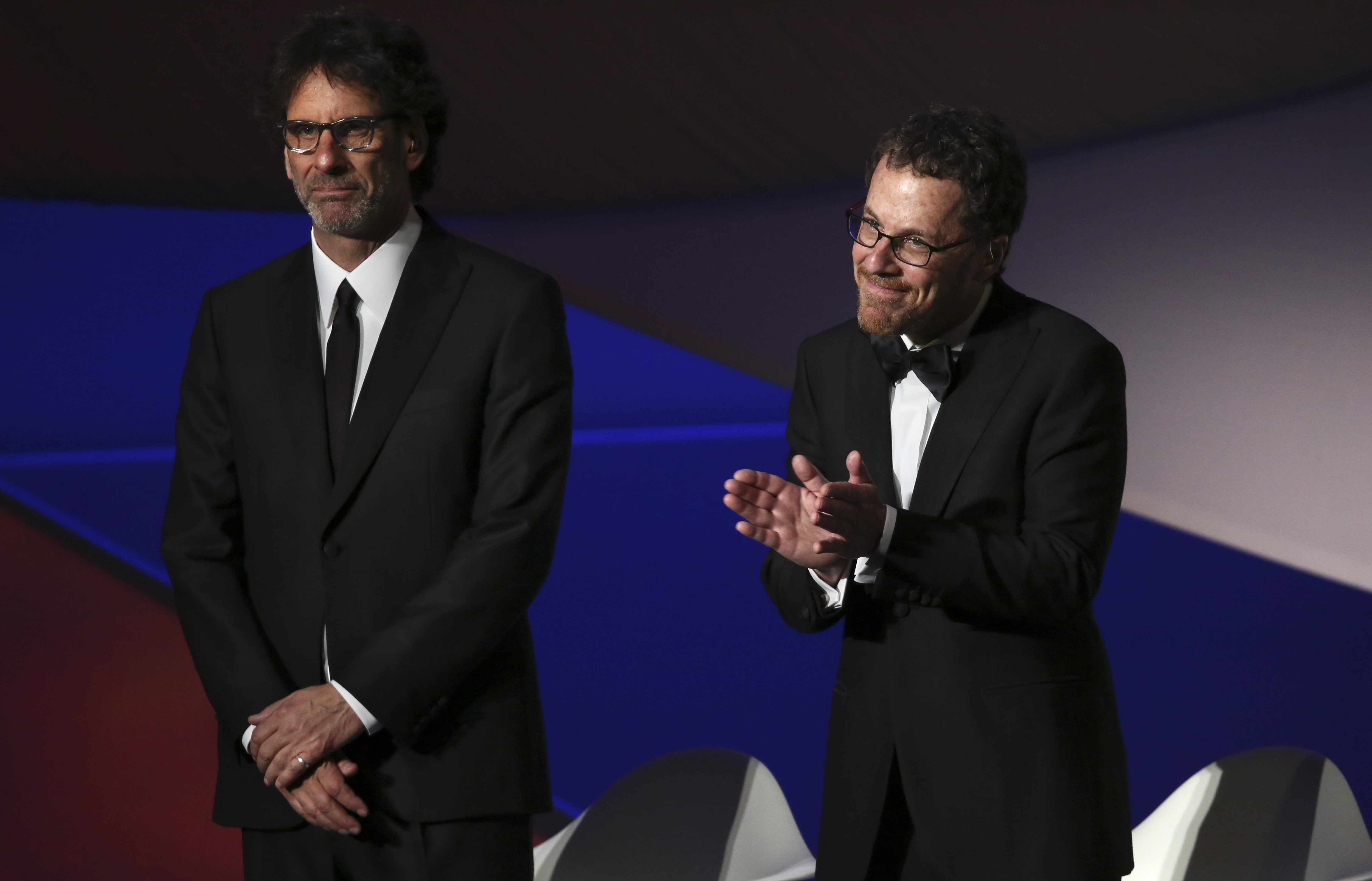 Jury presidents Ethan Coen, right, and Joel Coen stand on stage during the opening ceremony at the 68th international film festival, Cannes, southern France, Wednesday, May 13, 2015. (Photo by Joel Ryan/Invision/AP)