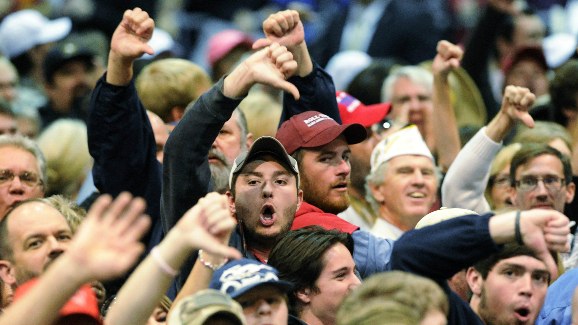 """Trump supporters """"boo"""" members of the media after a heckler was removed during a campaign stop by Republican presidential candidate Donald Trump in Birmingham, Alabama."""