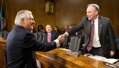 Senate Foreign Relations Committee member Sen. Tim Kaine D-Va., right, greets Secretary of State-designate Rex Tillerson on Capitol Hill in Washington, Wednesday, Jan. 11, 2017, prior to the start of Tillerson's confirmation hearing before the committee. (AP Photo/Steve Helber)