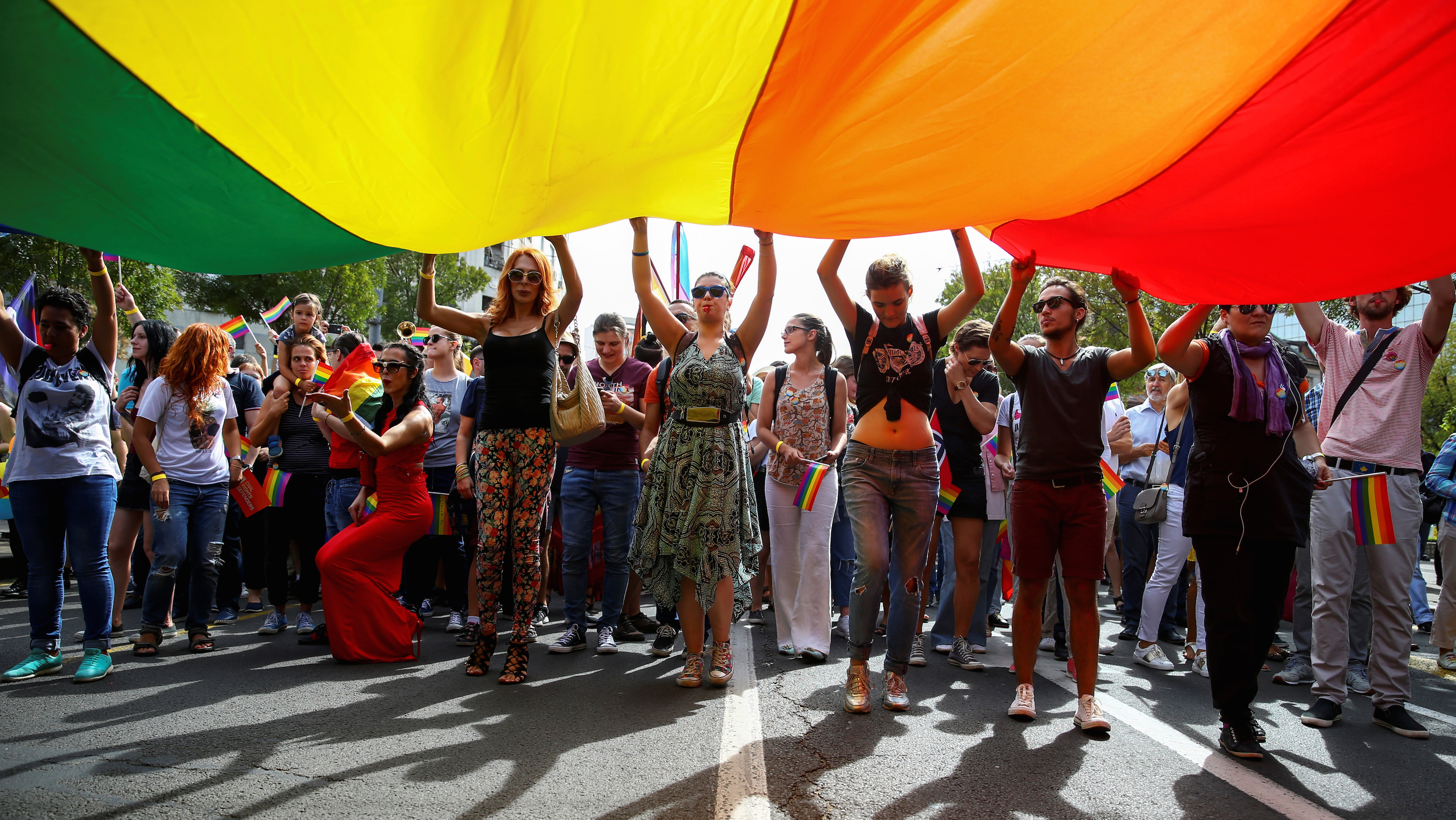 Participants hold a rainbow flag during an annual LGBT (Lesbian, Gay, Bisexual and Transgender) pride parade in Belgrade, Serbia September 18, 2016.