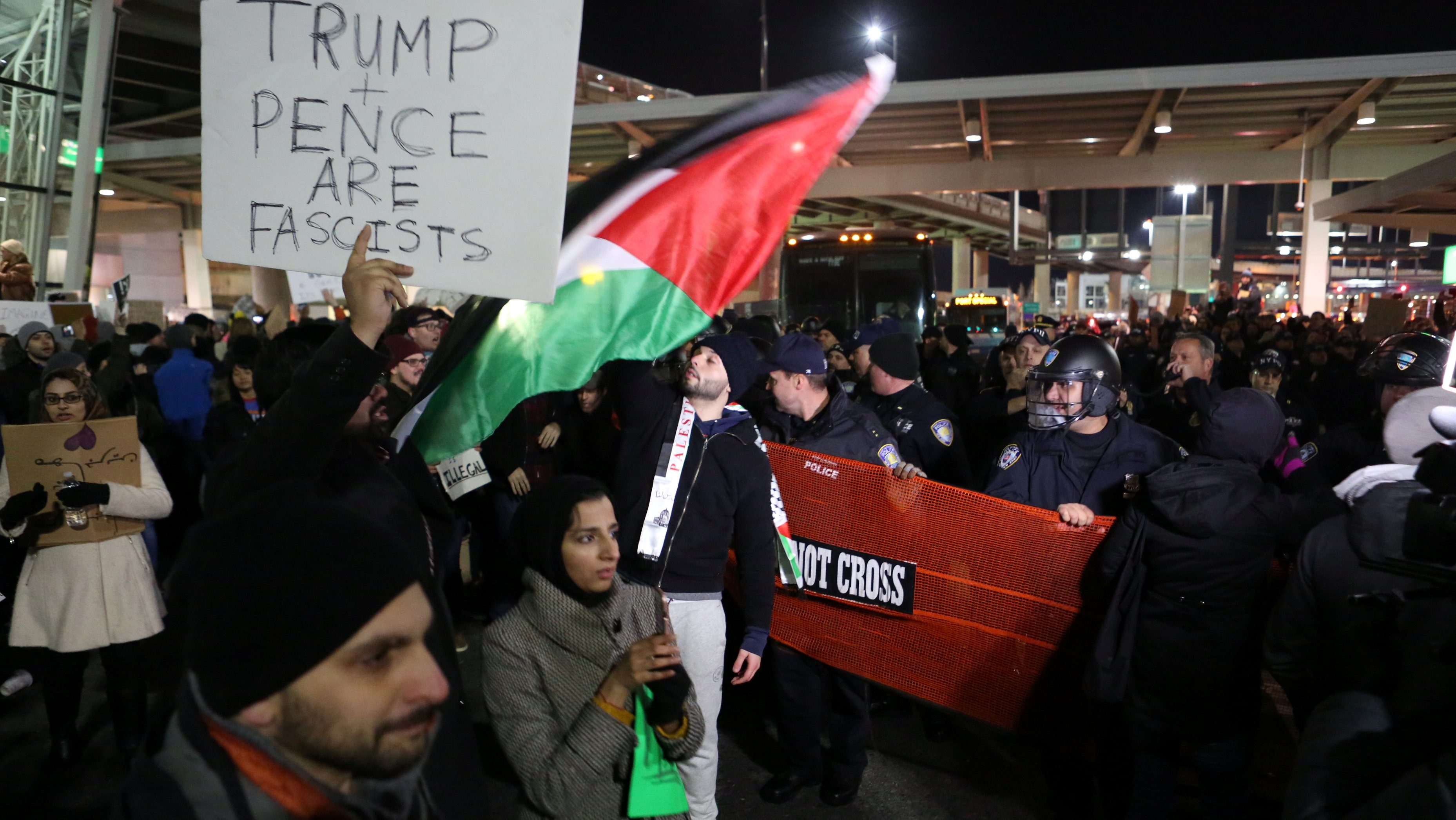 Police corral protesters who gathered in opposition to U.S. President Donald Trump's ban on immigration and travel outside Terminal 4 at JFK airport in Queens