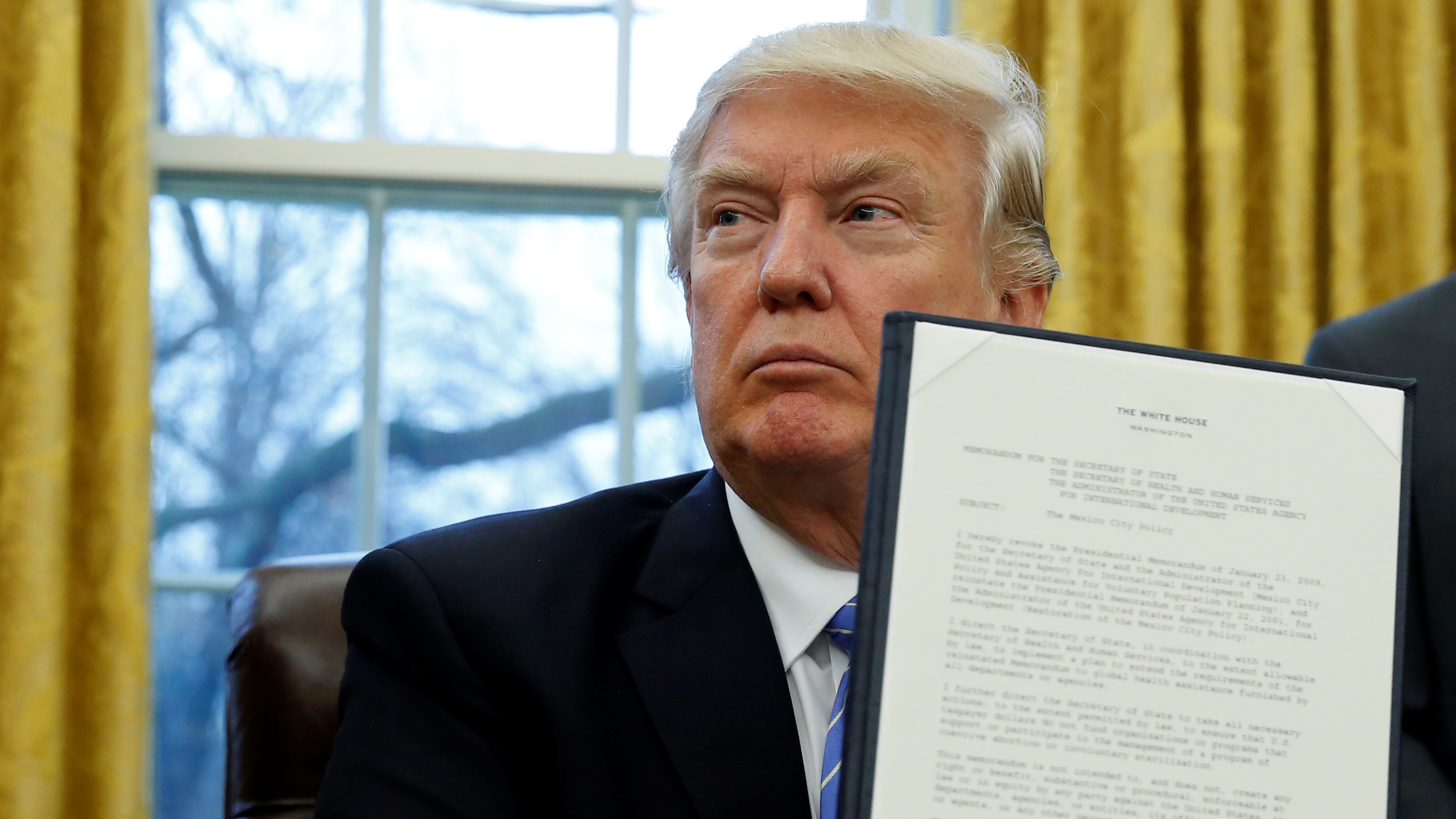 Trump holding signed executive order for reinstatement of Mexico City policy