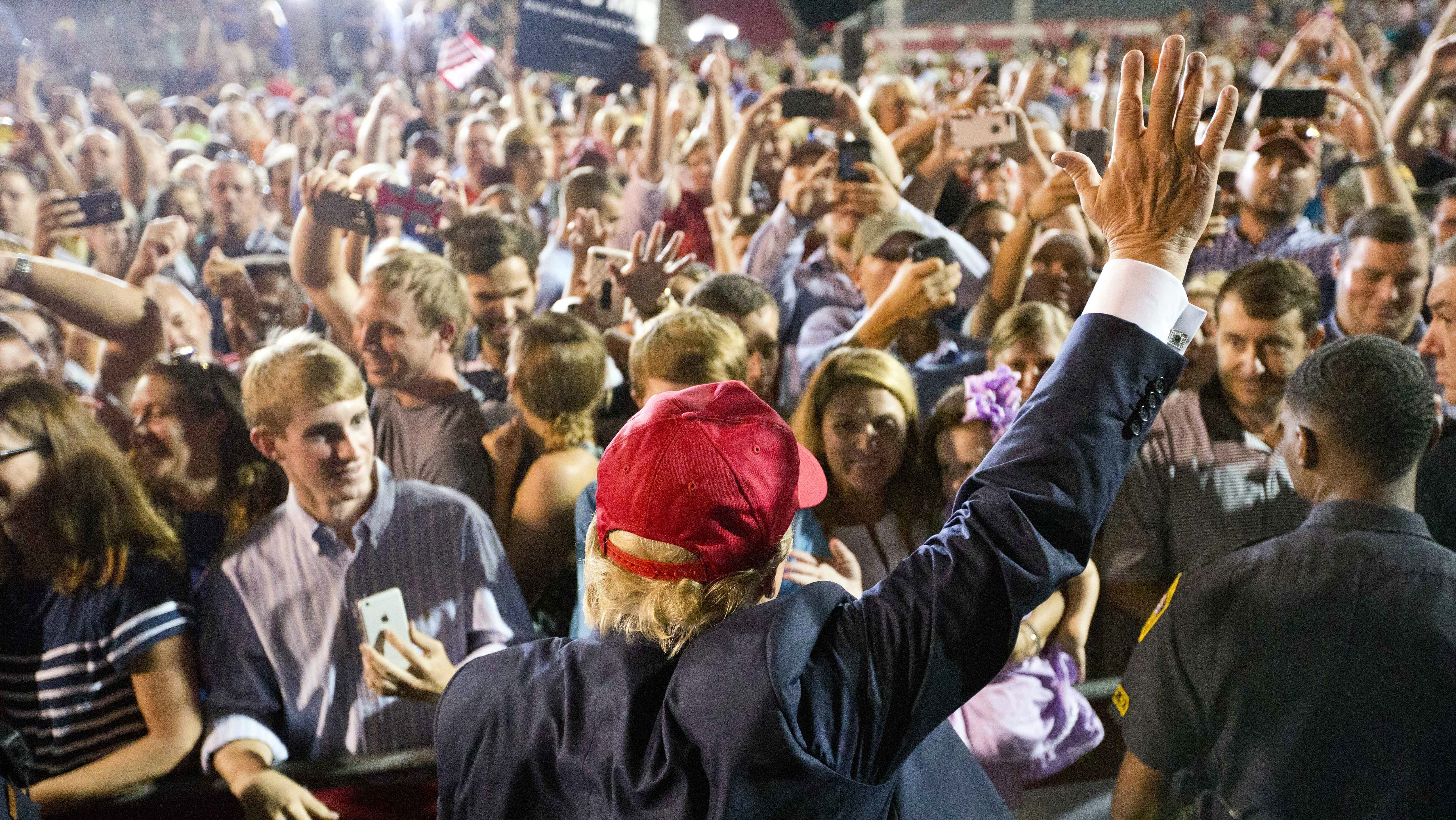 Republican presidential candidate Donald Trump waves to the crowd during a campaign pep rally, Friday, Aug. 21, 2015, in Mobile, Ala.