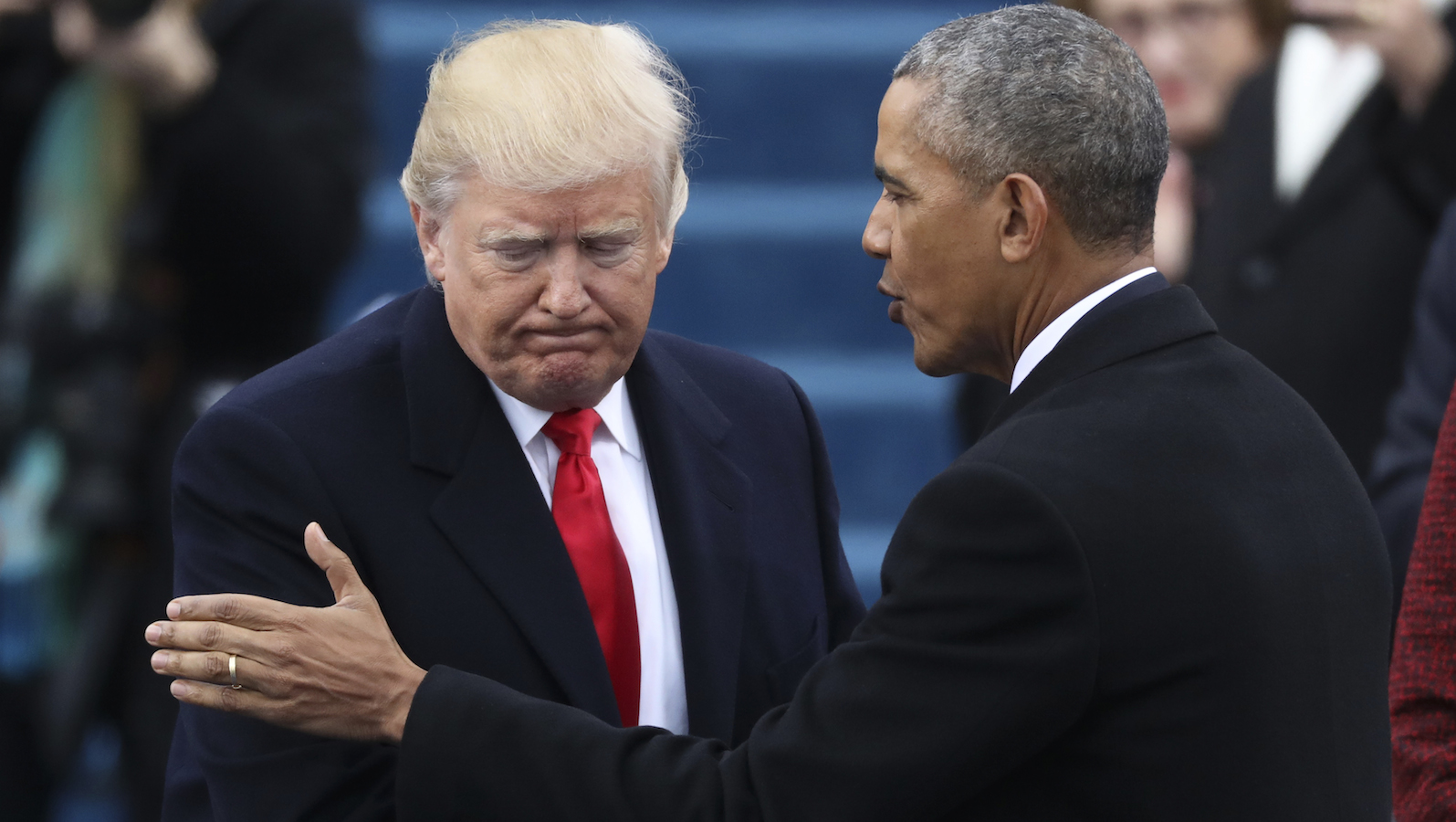 President Barack Obama (R) greets President elect Donald Trump at inauguration ceremonies swearing in Donald Trump as the 45th president of the United States on the West front of the U.S. Capitol in Washington, U.S., January 20, 2017. REUTERS/Carlos Barria  - RTSWIZD
