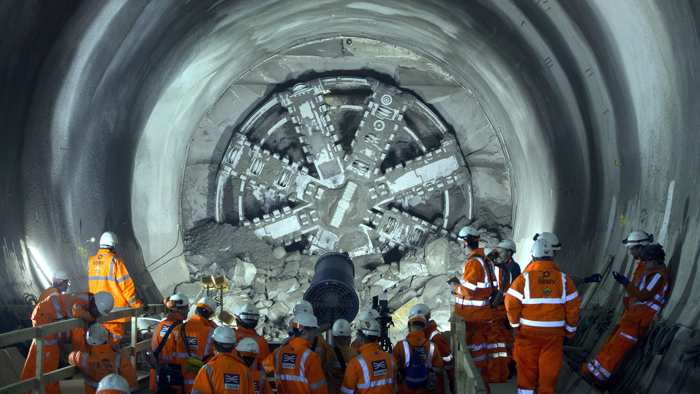 Workers view the tunnel boring machine Victoria as it breaks into the eastern end of the Liverpool Street Crossrail station in London, March 10, 2015. Liverpool Street is one of 10 new Crossrail stations being built in London, as part of a new railway line due to be operational in 2019.