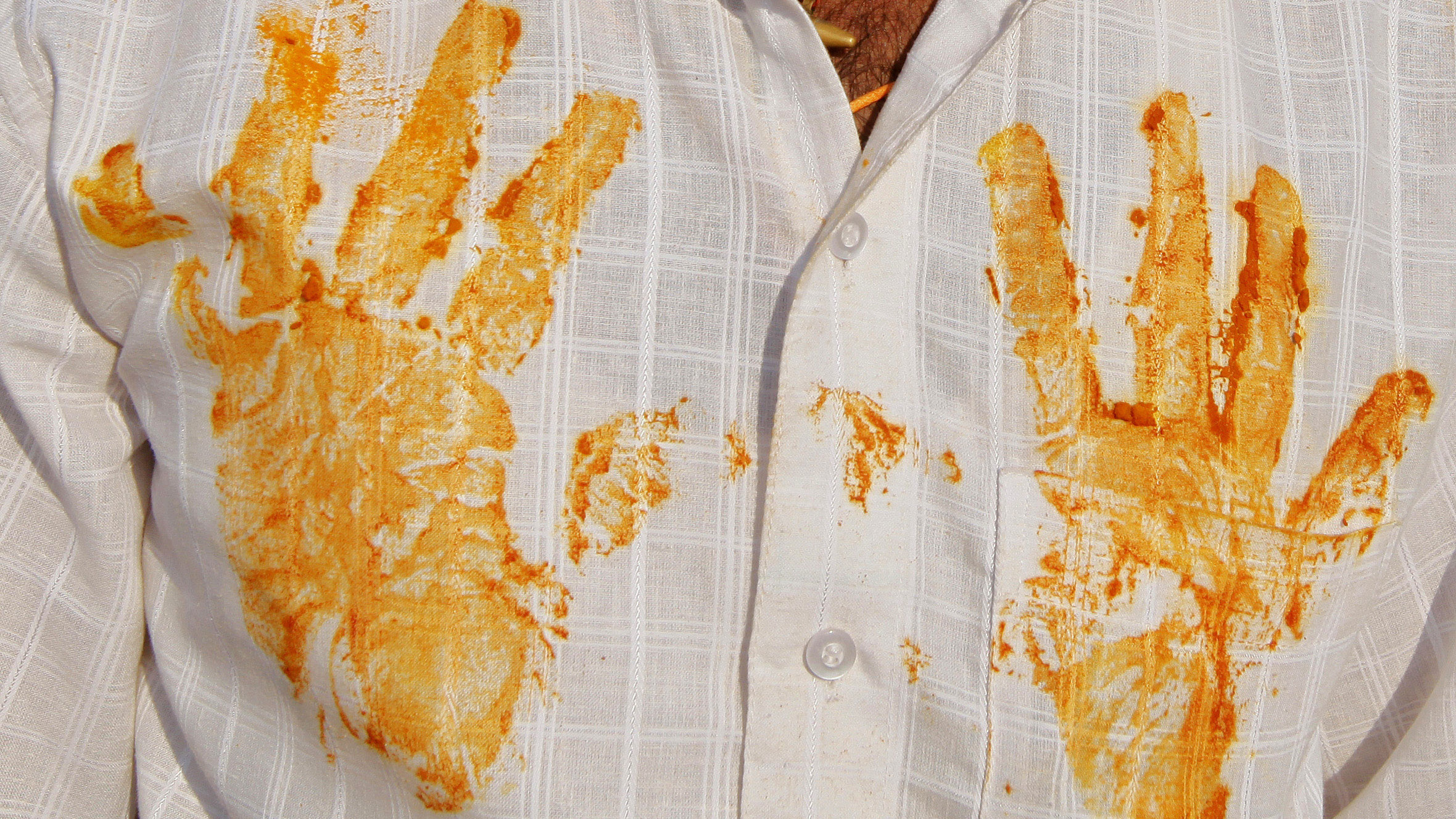 In this Monday, March 11, 2013 photo, a devotee's shirt has hand prints of turmeric during a procession at the temple of the shepherd god Khandoba on 'Somavati Amavasya' at the Jejuri temple in Pune district, Maharashtra state, India. 'Somavati Amavasya' is the day when a New Moon falls on a Monday. (AP Photo/Rajanish Kakade)