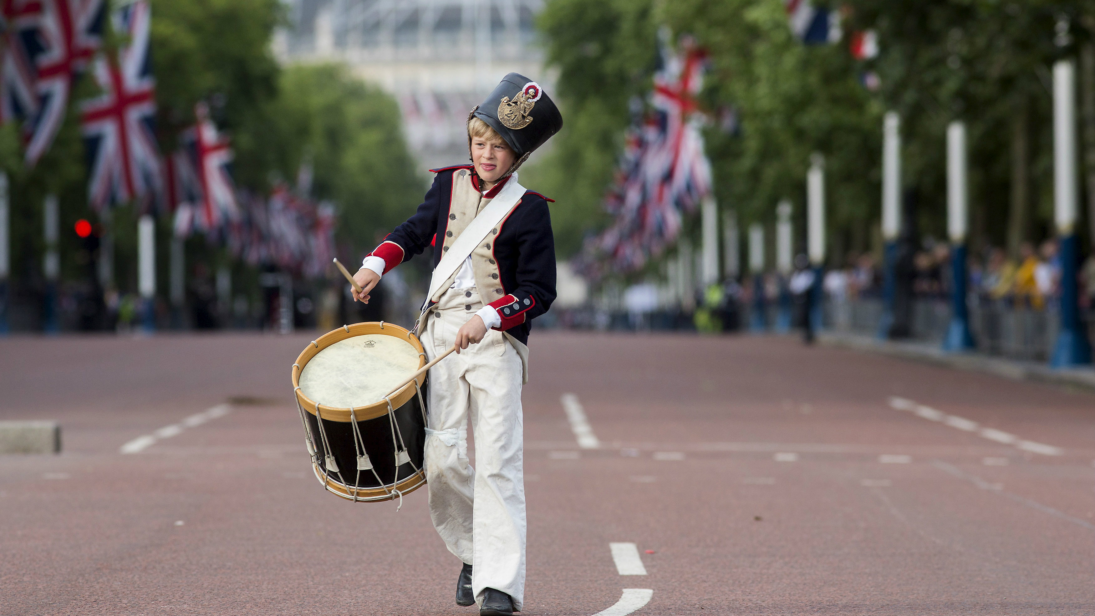 Drummer parades along the mall in London, UK