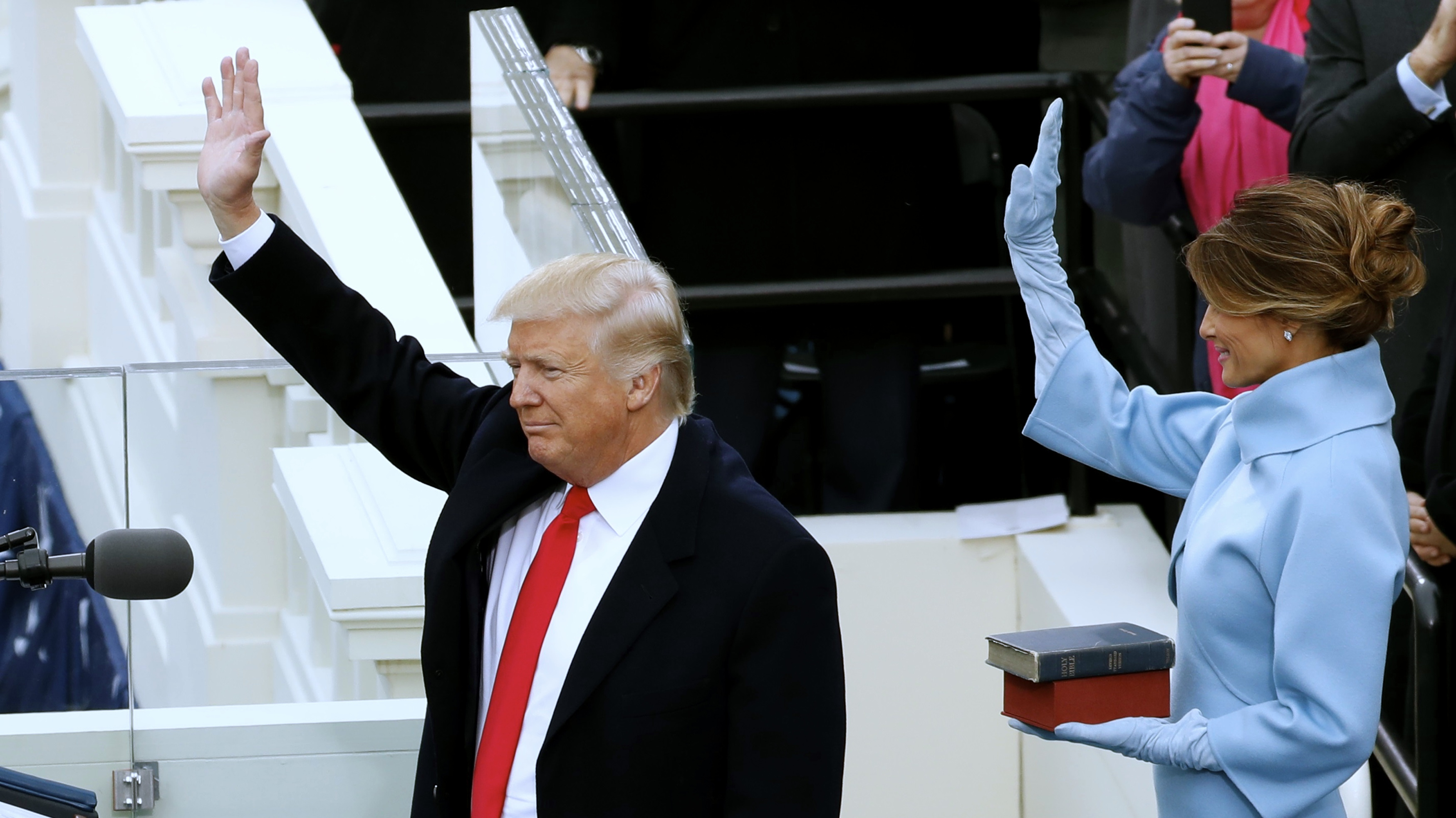 Donald Trump and his wife Melania wave to crowd after he was sworn in as the 45th president.