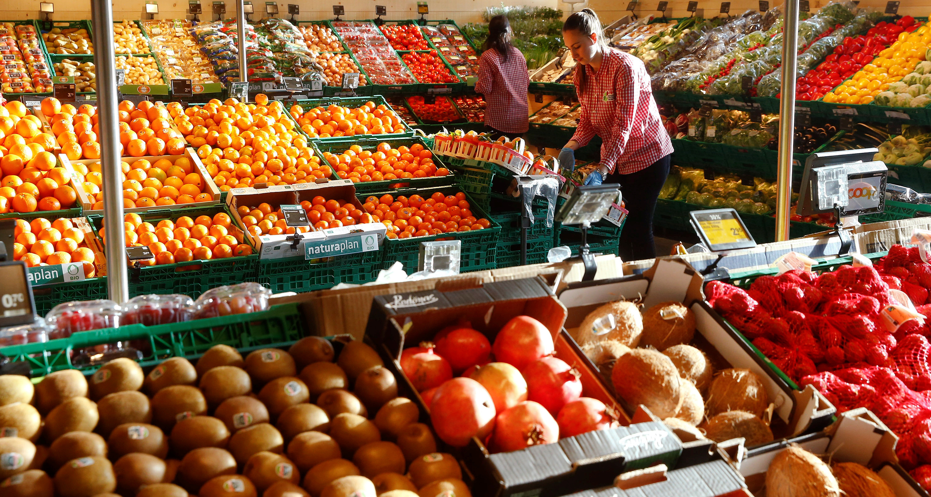 Woman shops for fruits and vegetables