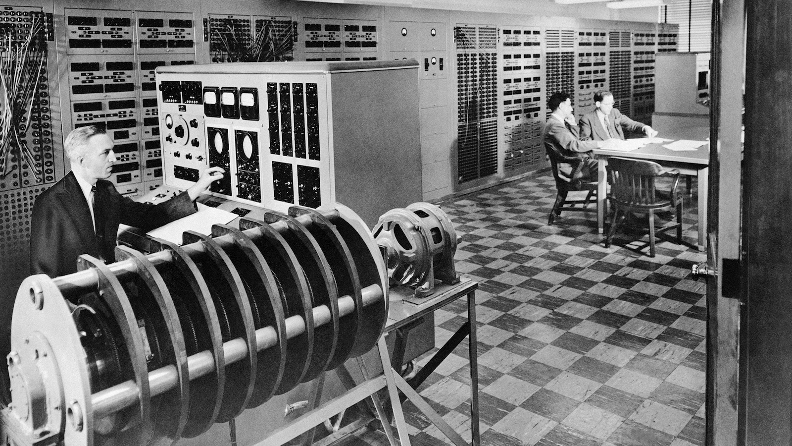 How far can you drop a box of eggs without breaking any of them? An electronic brain, weighing three tons, could tell you, without harming a single egg. It could set up electrical models of the eggs and box, and show what kind of fall would crack the eggs. Shown is the 6,000 pound computer which fills 13 cabinets has 25 miles of wire and 2,500 electrical switches and cabinets. The electric analog computer named ANACOM shown here is housed at Caltech in Southern California, July 26, 1950. (AP Photo)