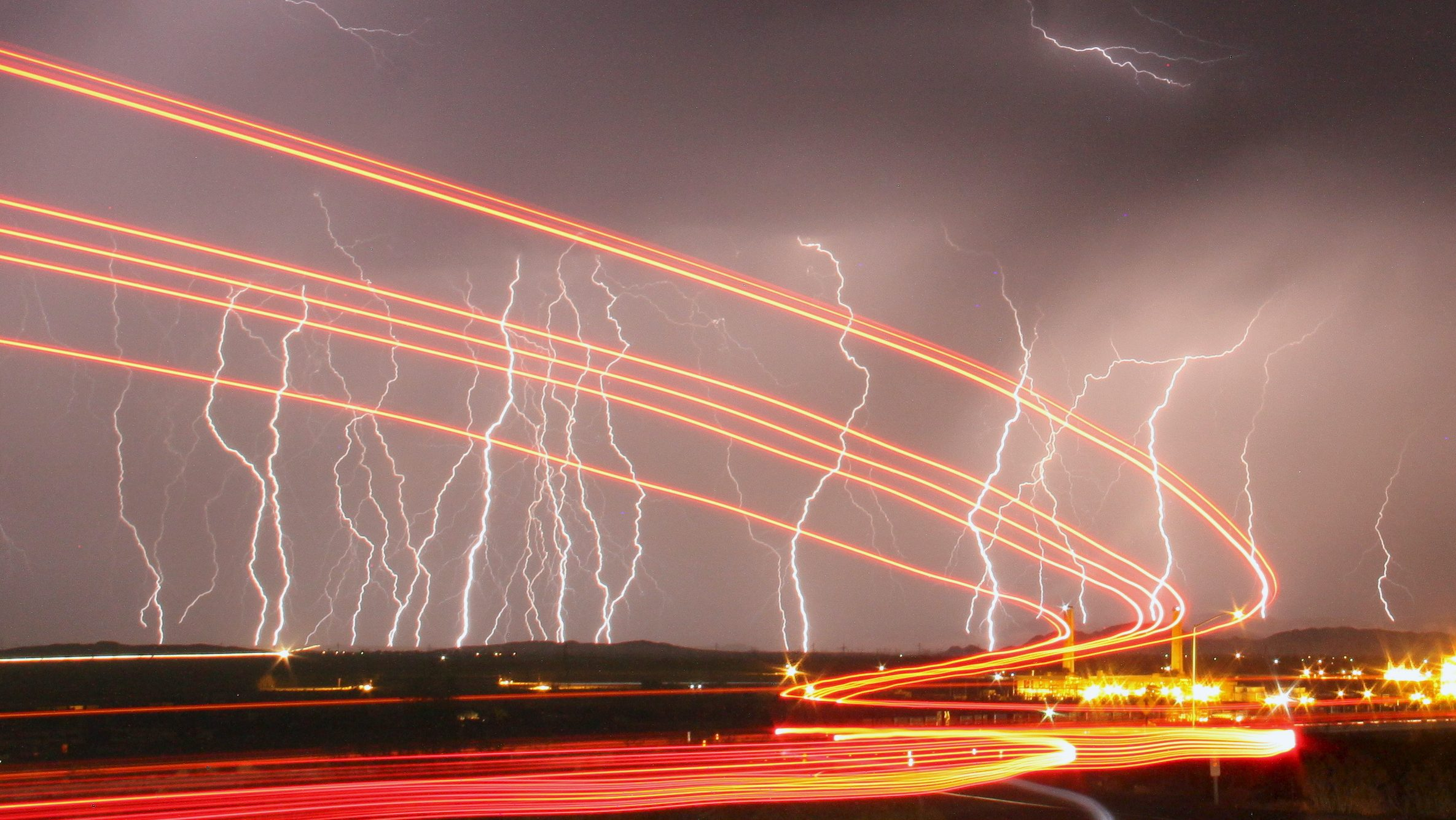 Mass lightning bolts light up night skies by the Daggett airport from monsoon storms passing over the high deserts early Wednesday, north of Barstow, California July 1, 2015. Picture taken using long exposure.
