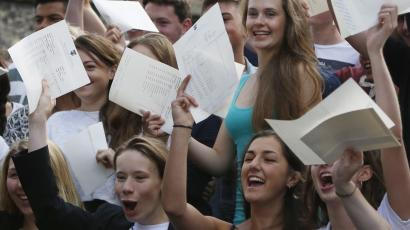 Female students with exam results.