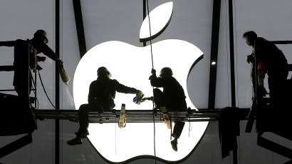 workers with Apple logo
