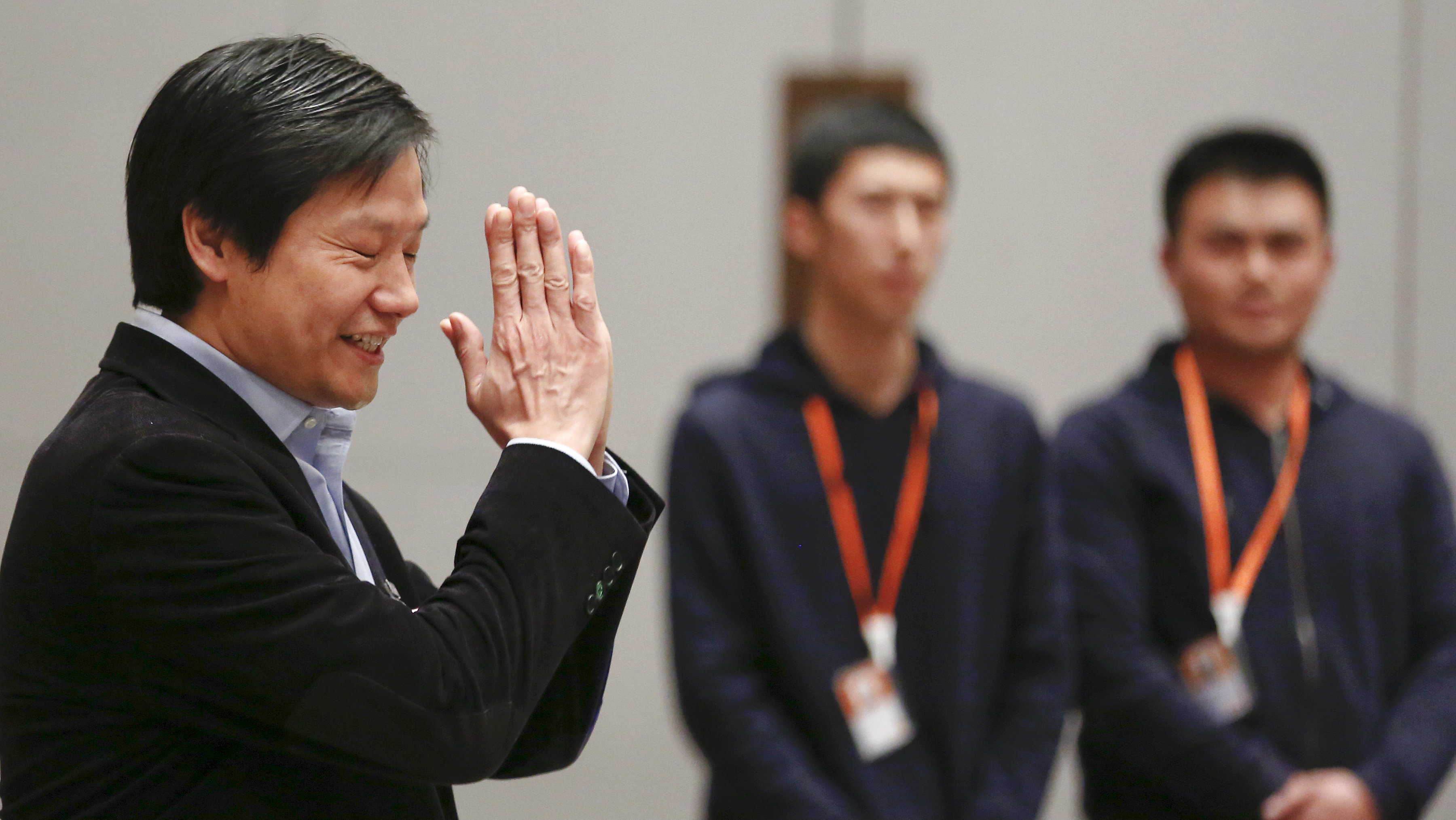 Lei Jun, founder and CEO of China's mobile company Xiaomi gestures as he attends a press conference during the period of Chinese People's Political Consultative Conference (CPPCC) and National People's Congress (NPC) in Beijing, China