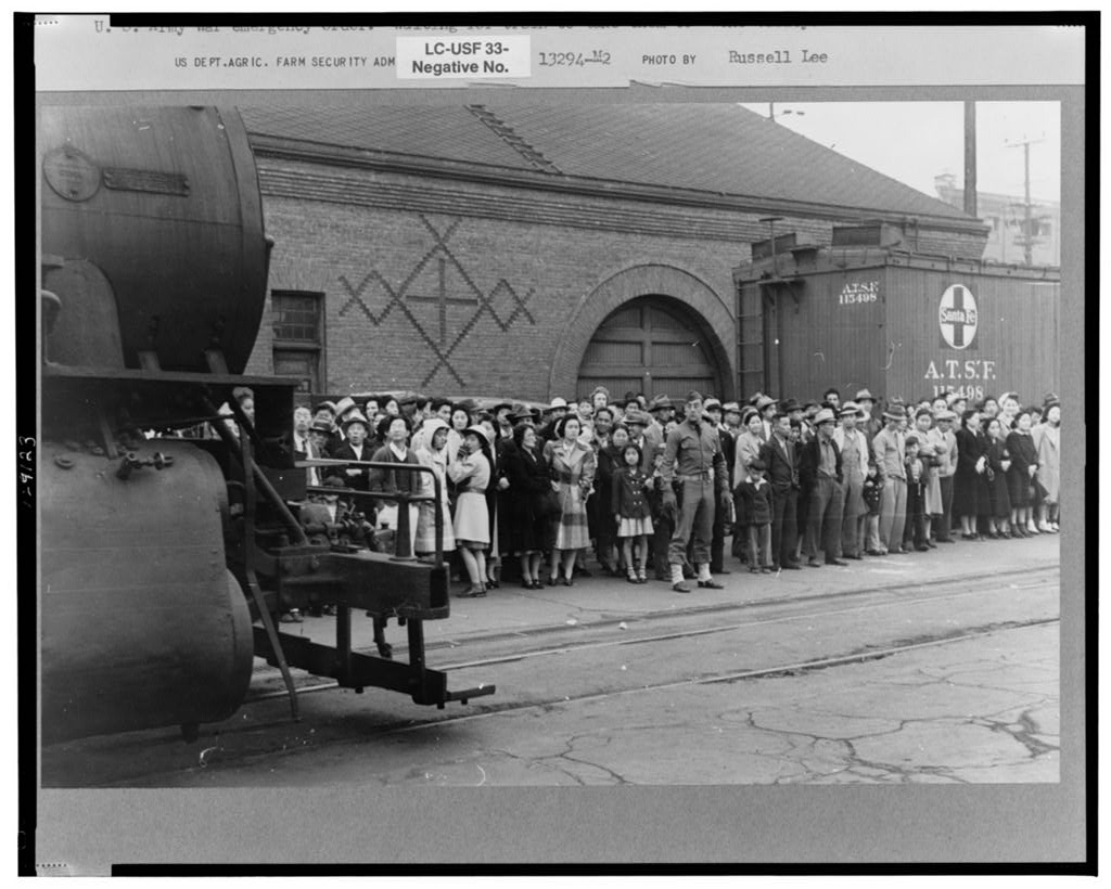 The evacuation of Japanese-Americans from West Coast areas under U.S. Army war emergency order. Waiting for train to take them to Owens Valley.