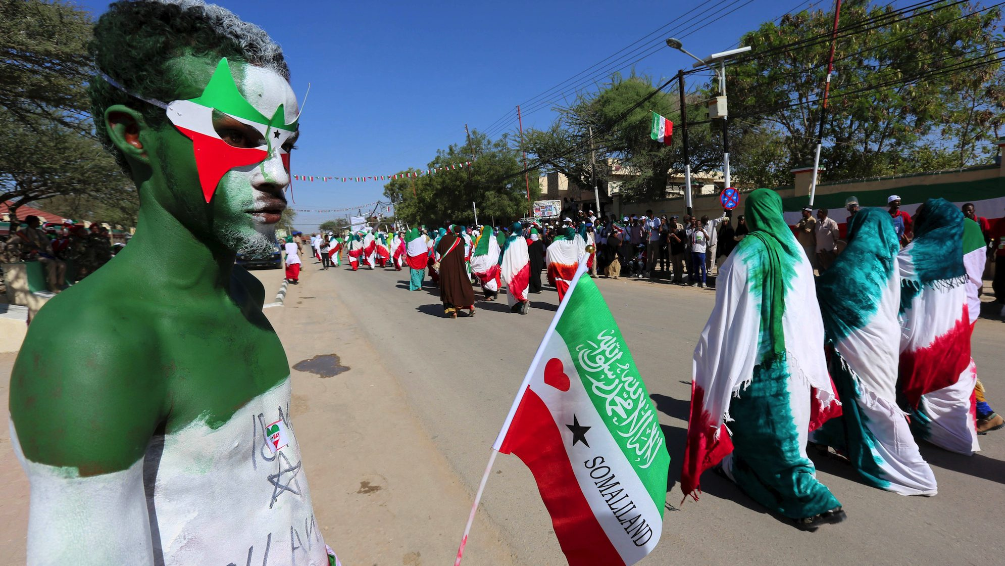 A man with body paint in the colours of the national flag participates in a street parade to celebrate the 24th self-declared independence day for the breakaway Somaliland nation from Somalia in capital Hargeysa