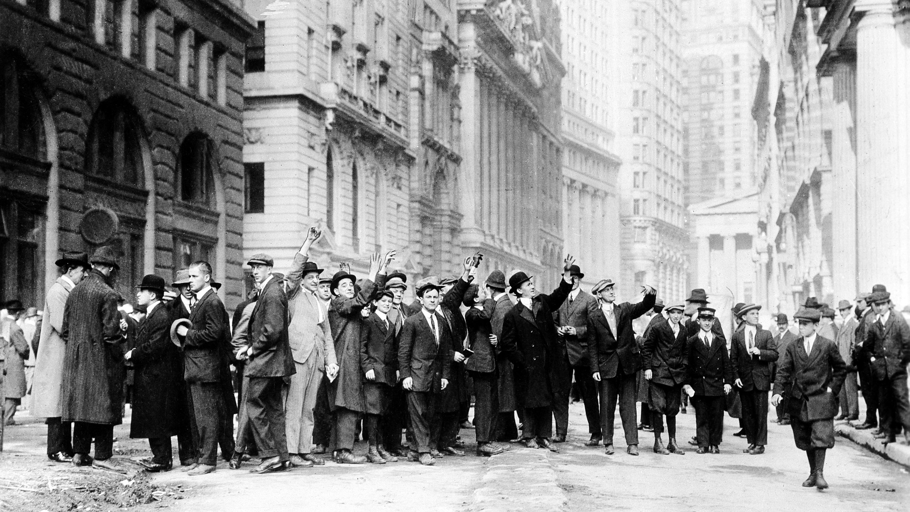 A group of traders of the Curb Exchange, predecessor to the American Stock Exchange, are seen on Broad Street in New York, in this photograph from the early 1900's.  (AP Photo )