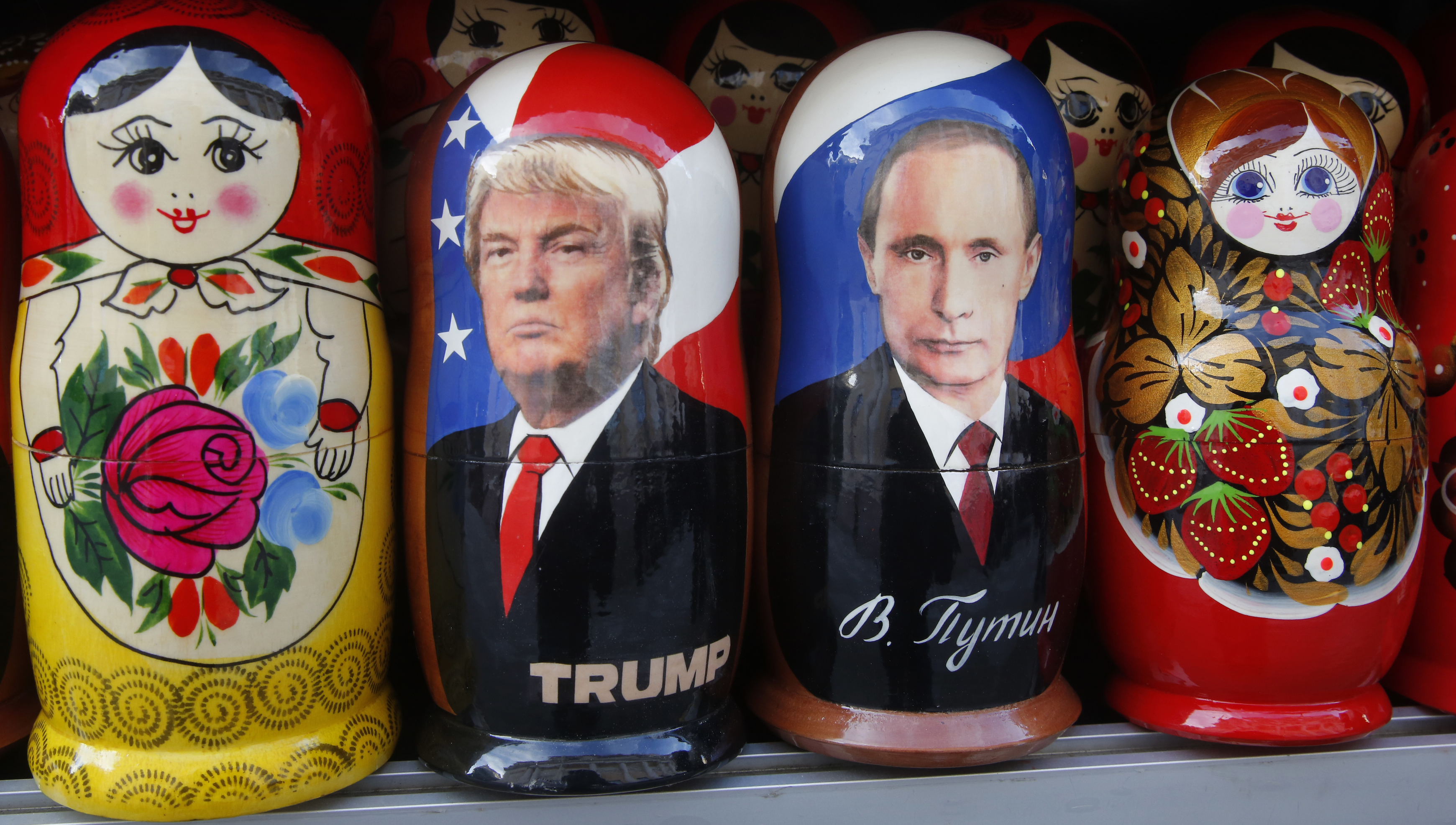 Traditional Russian wooden dolls called Matryoshka depicting Russian President Vladimir Putin and Donald Trump, hours before Donald Trump is to be sworn in as president of the United States, are displayed for sale at a street souvenir shop in St. Petersburg, Russia, Friday, Jan. 20, 2017.