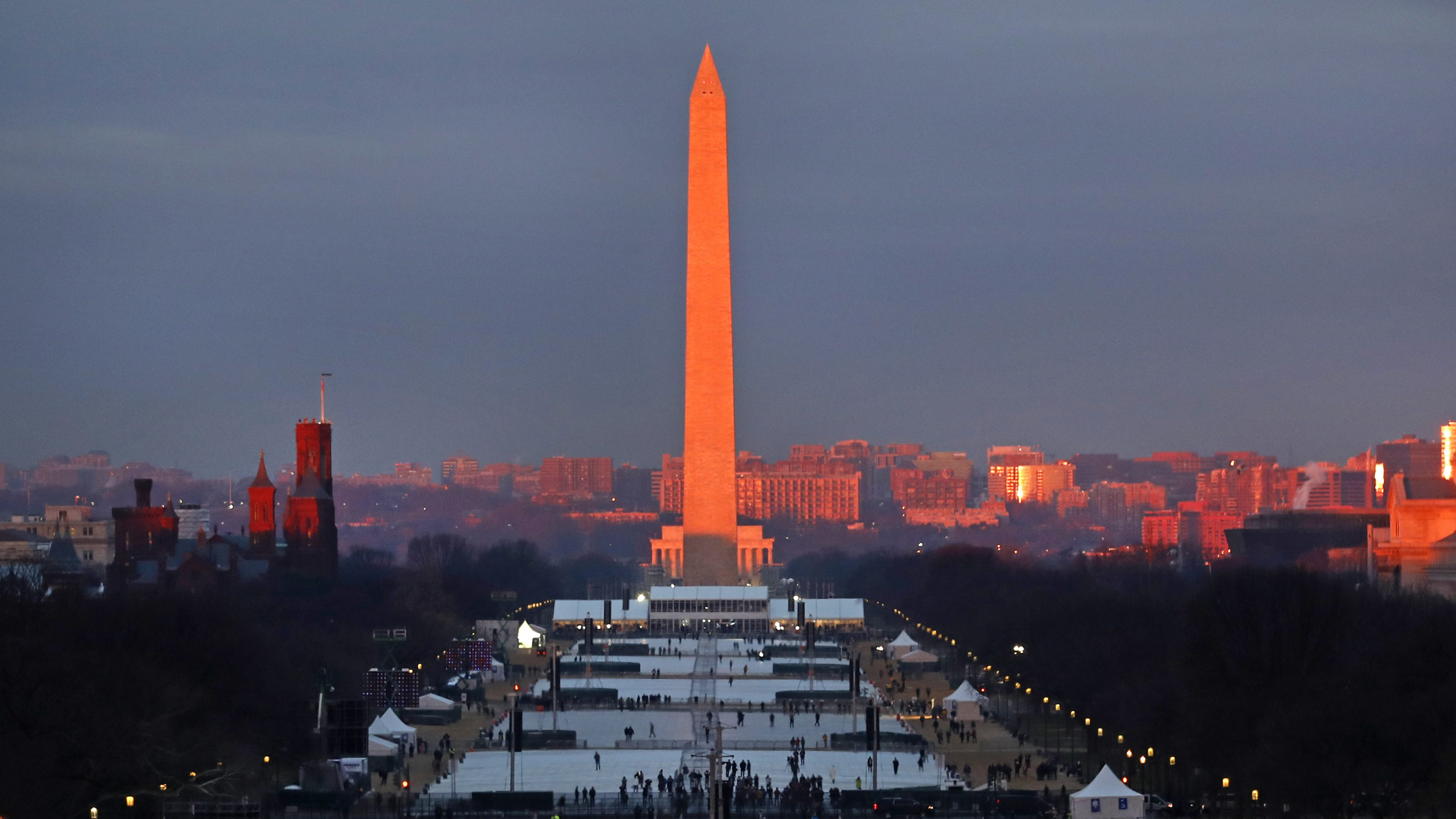 The crowd starts to fill the National Mall as the sun rises before the swearing in of Donald Trump as the 45th President of the Untied State during the 58th Presidential Inauguration at the U.S. Capitol in Washington. Friday, Jan. 20, 2017 (AP Photo/Carolyn Kaster)