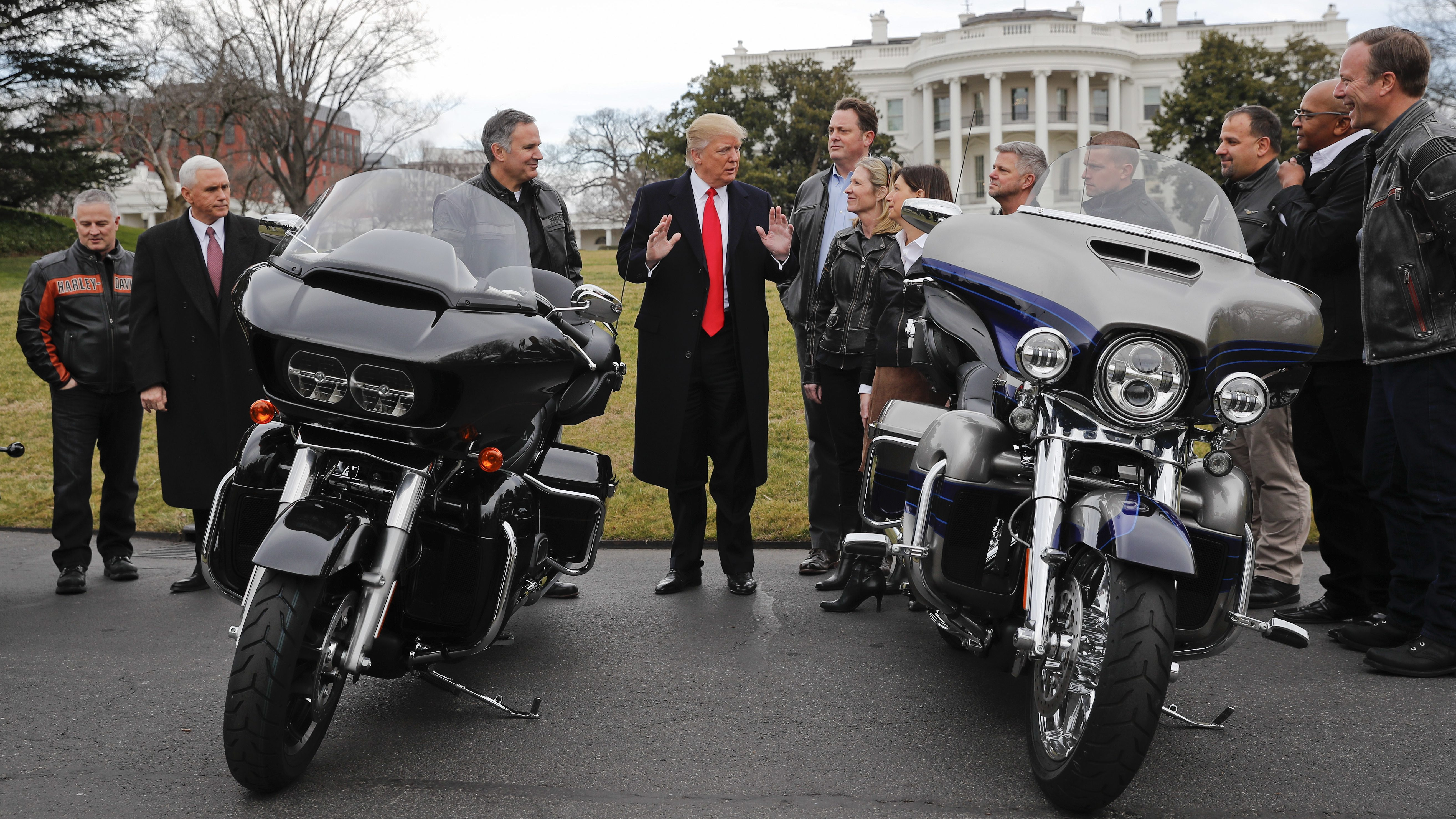 President Donald Trump and Vice President Mike Pence meet with Harley Davidson executives and Union Representatives on the South Lawn of the White House in Washington, Thursday, Feb. 2, 2017. ()