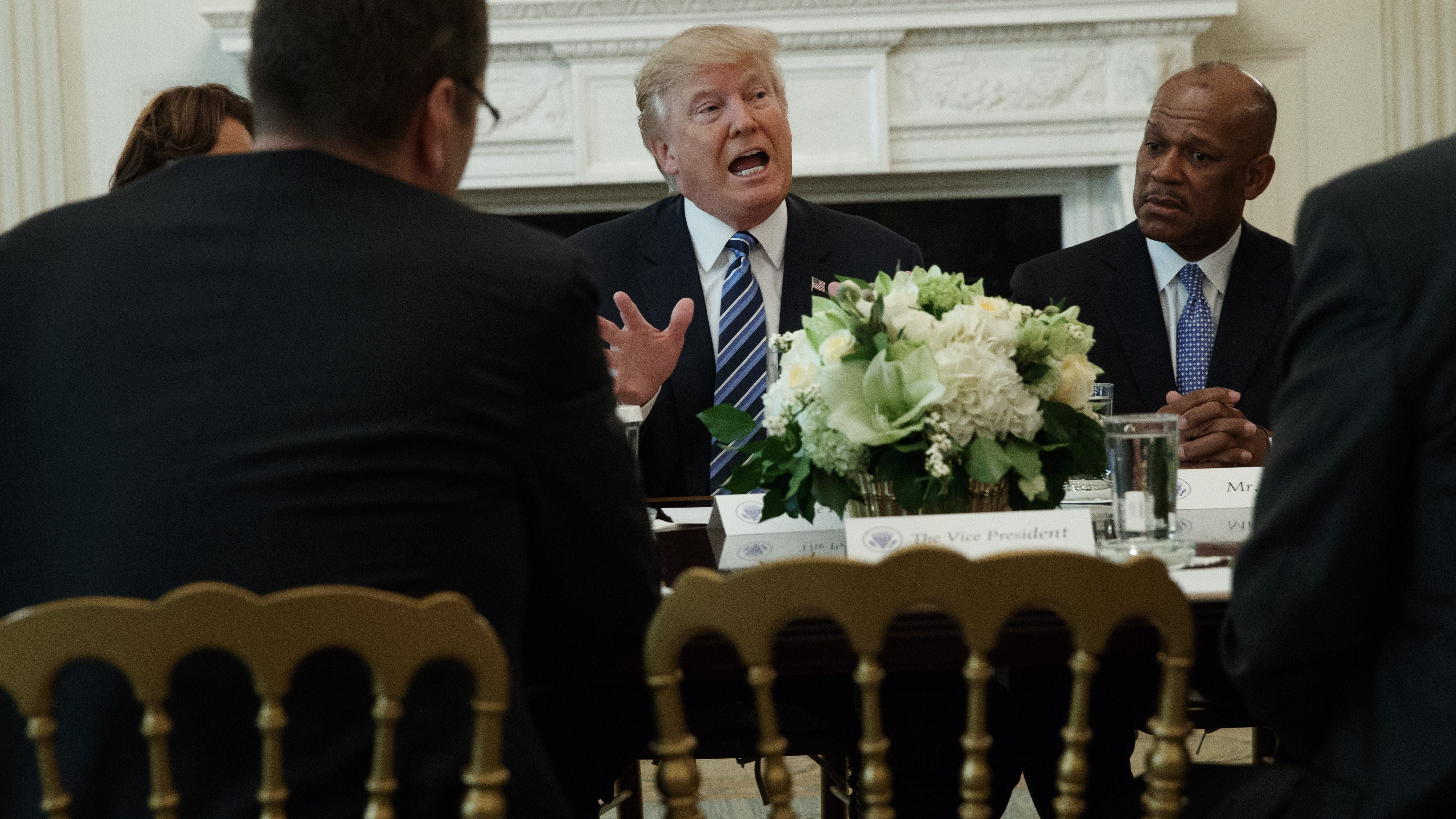 UPS President of US operations Myron Gray, right, listens as President Donald Trump speaks during a meeting with airline executives in the State Dining Room of the White House in Washington, Thursday, Feb. 9, 2017. (AP Photo/Evan Vucci)