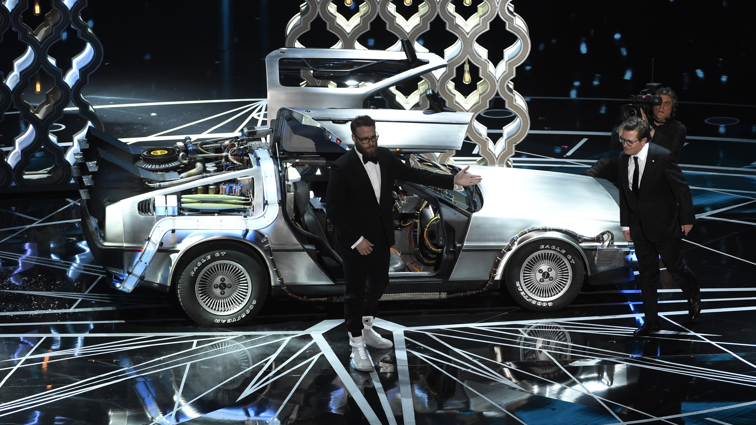Seth Rogen, left, and Michael J. Fox step out of a DeLorean onstage at the Oscars on Sunday, Feb. 26, 2017, at the Dolby Theatre in Los Angeles. (Photo by Chris Pizzello/Invision/AP)