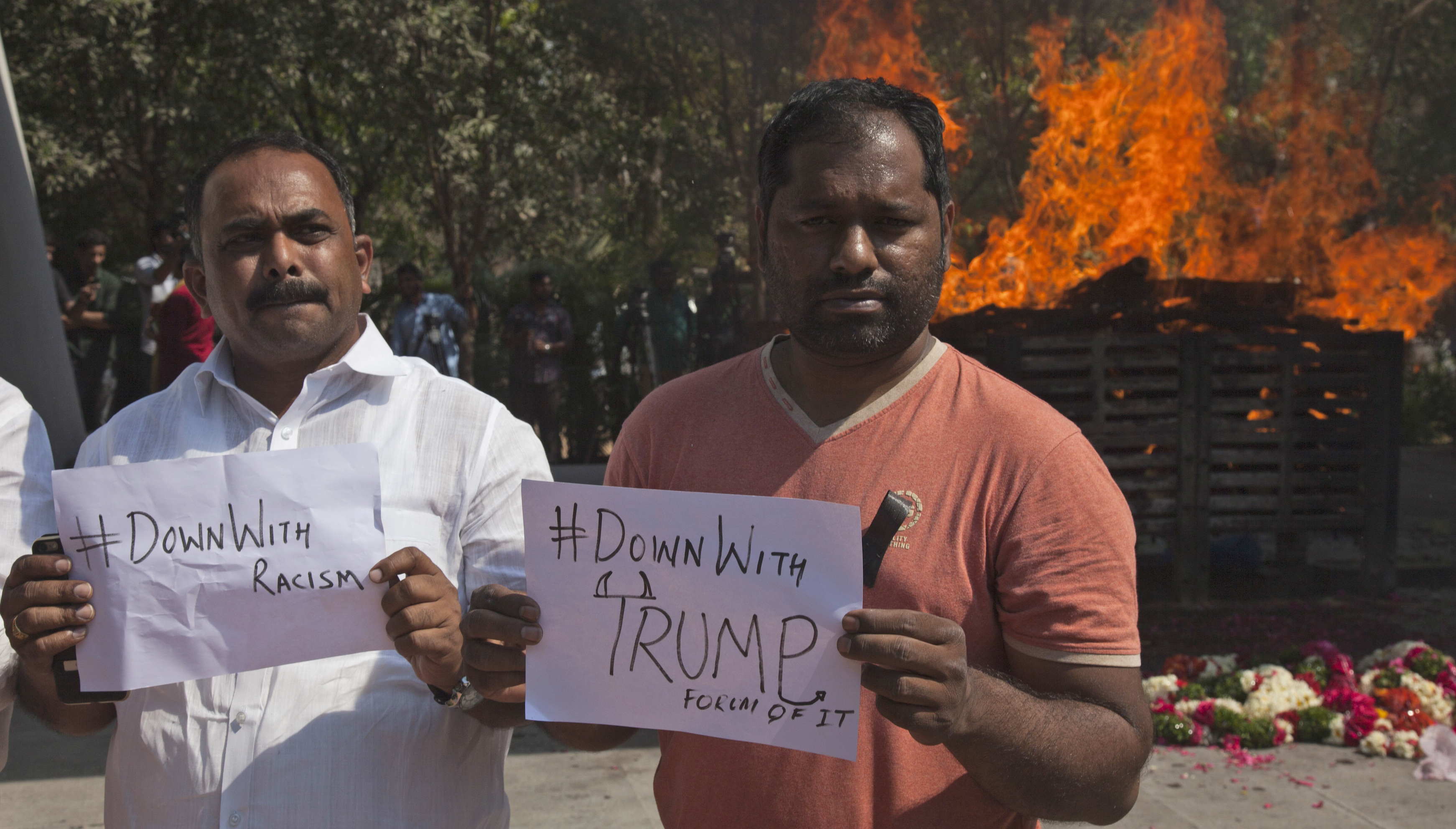 Supporters of Srinivas Kuchibhotla hold placards in a protest against racism