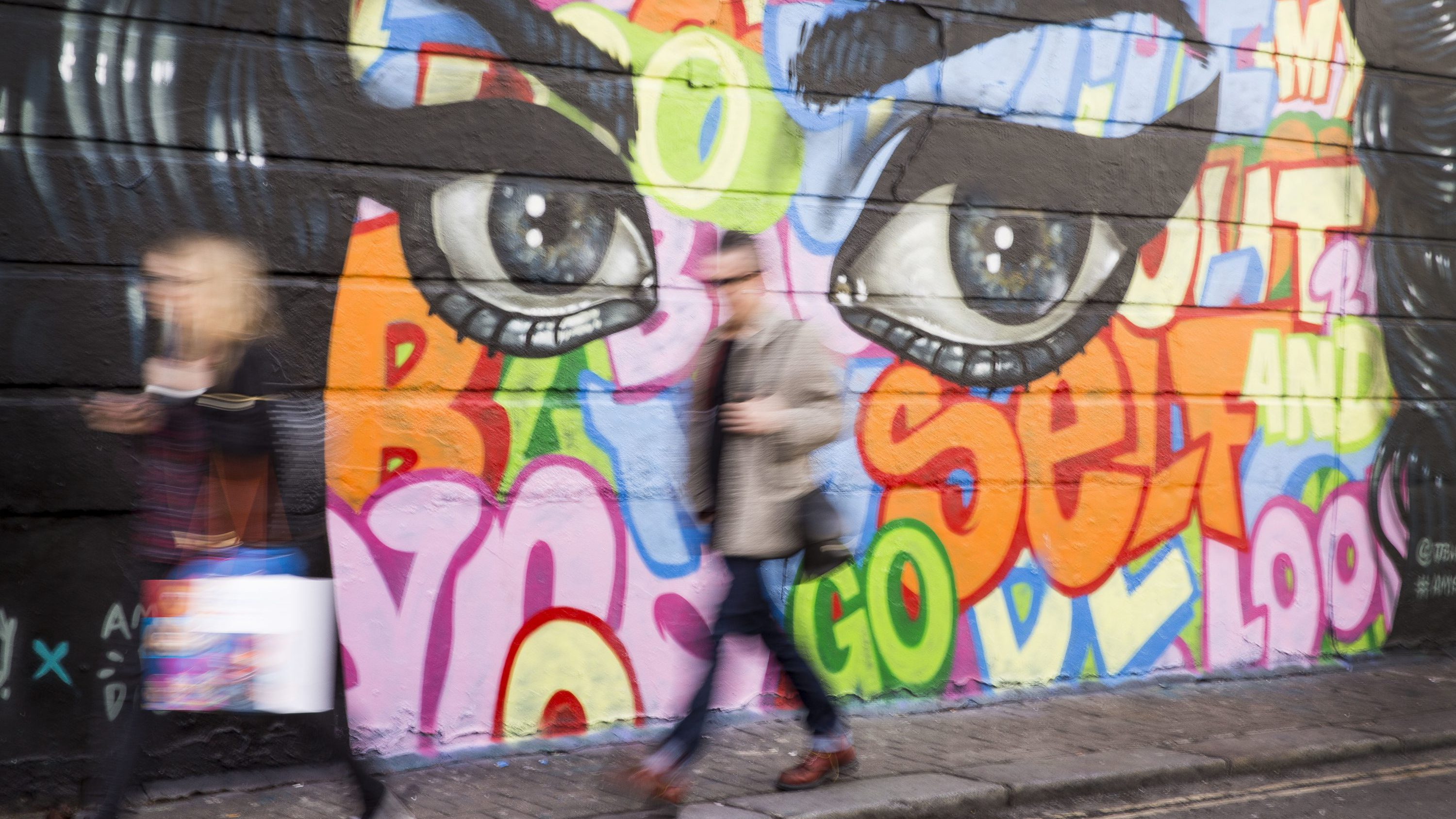 Members of the public walk past Amy Winehouse street art in her hometown of Camden, north London, Monday, March. 6, 2017, as her life is to be celebrated with a new art trail crowdfunded via Art Happens. The Amy Winehouse Street Art Trail will run from March 15 until June 4 2017.