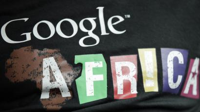 In this photo taken, Thursday, Sept.13, 2012. A staff member wears a T-shirt bearing the name of Google Africa, in Lagos, Nigeria. With all its cutting-edge technology, Google Inc. has turned back to the text message in its efforts to break into Nigeria's booming economy. The search engine has started a service in Nigeria, as well as Ghana and Kenya, allowing mobile phone users to access emails through text messaging. That comes as the company's office in Lagos has begun working with small business owners in this nation of more than 160 million people.