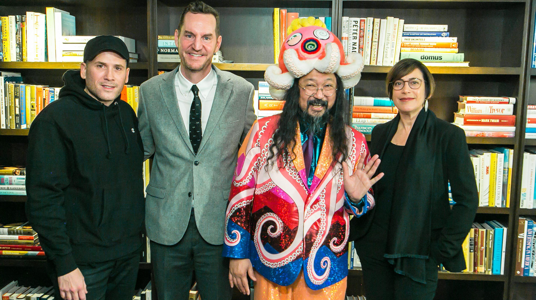 Murakami mugs with fashion designer Marc Ecko and MCA museum curators.