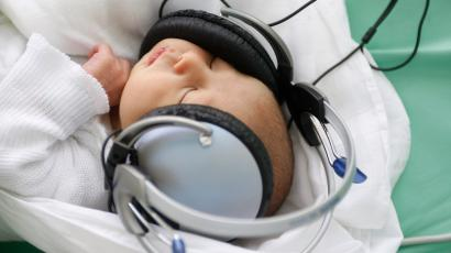 baby listening to music on headphones