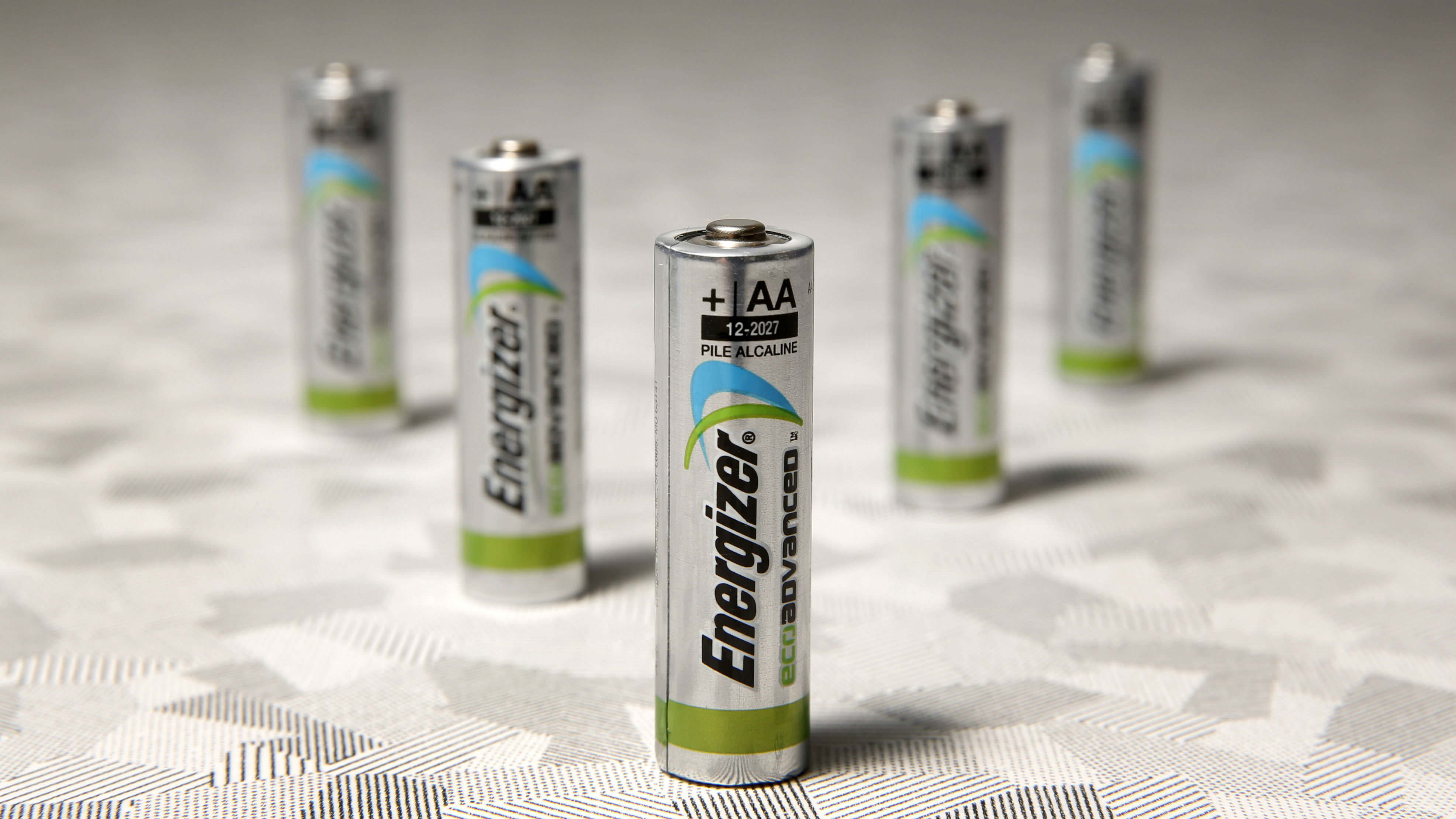 a lineup of five energizer batteries arranged in a pyramid shape.