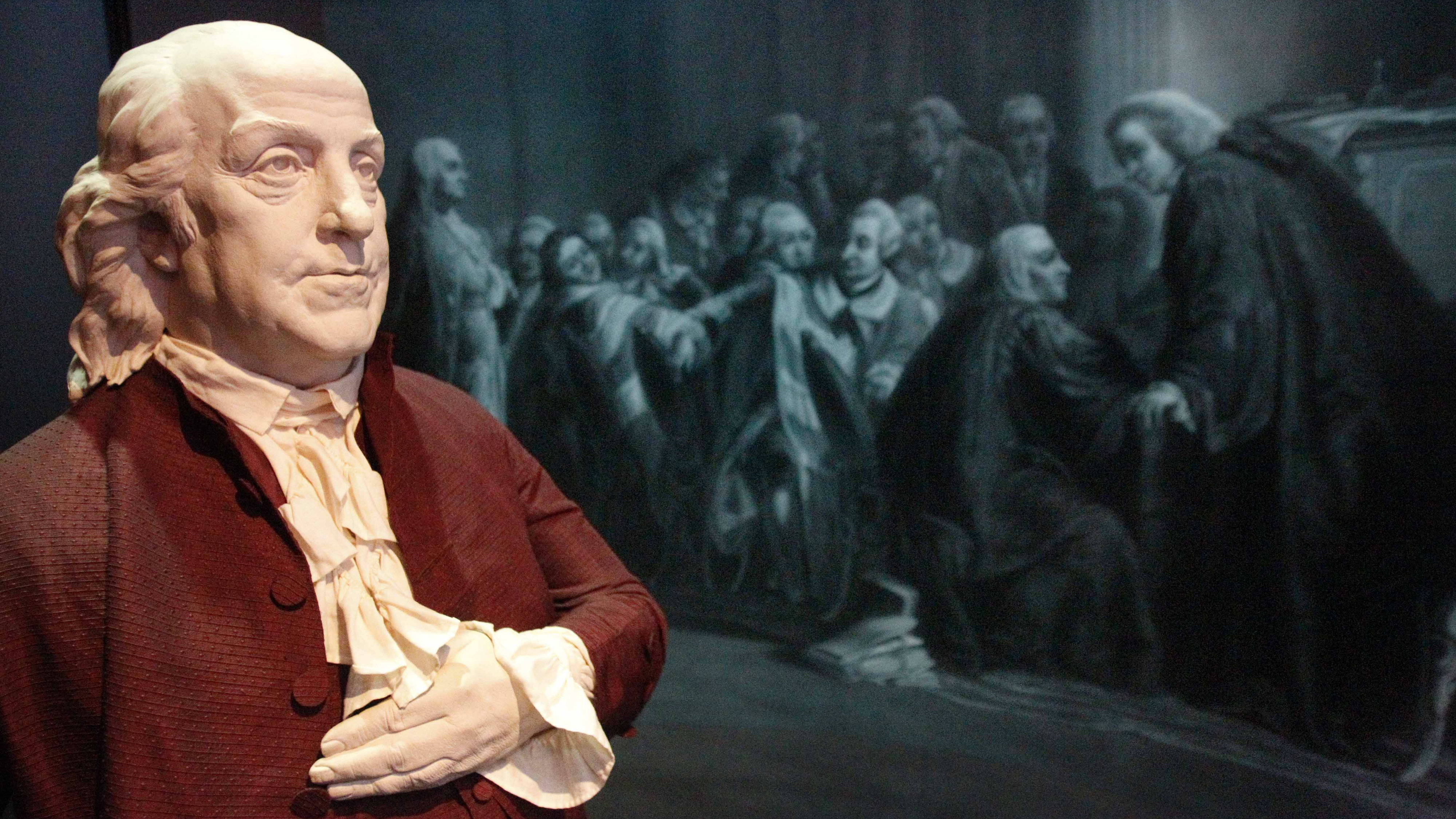 In this April 12, 2011 photo, a figure of Benjamin Franklin is seen before the opening of the traveling exhibit on Benjamin Franklin scheduled to run from April 16 through July 31, 2011 at the Senator John Heinz History Center in Pittsburgh. Franklin is shown in front of artwork representing his 1774 questioning in England where Lord Alexander Wedderburn accused Franklin of leaking letters to provoke colonial riots against the Crown. (AP Photo/Keith Srakocic)