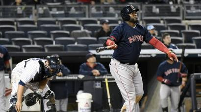 Boston Red Sox's David Ortiz watches his home run as New York Yankees catcher Brian McCann, left, reacts during the 16th inning of a baseball game Friday, April 10, 2015, at Yankee Stadium in New York.