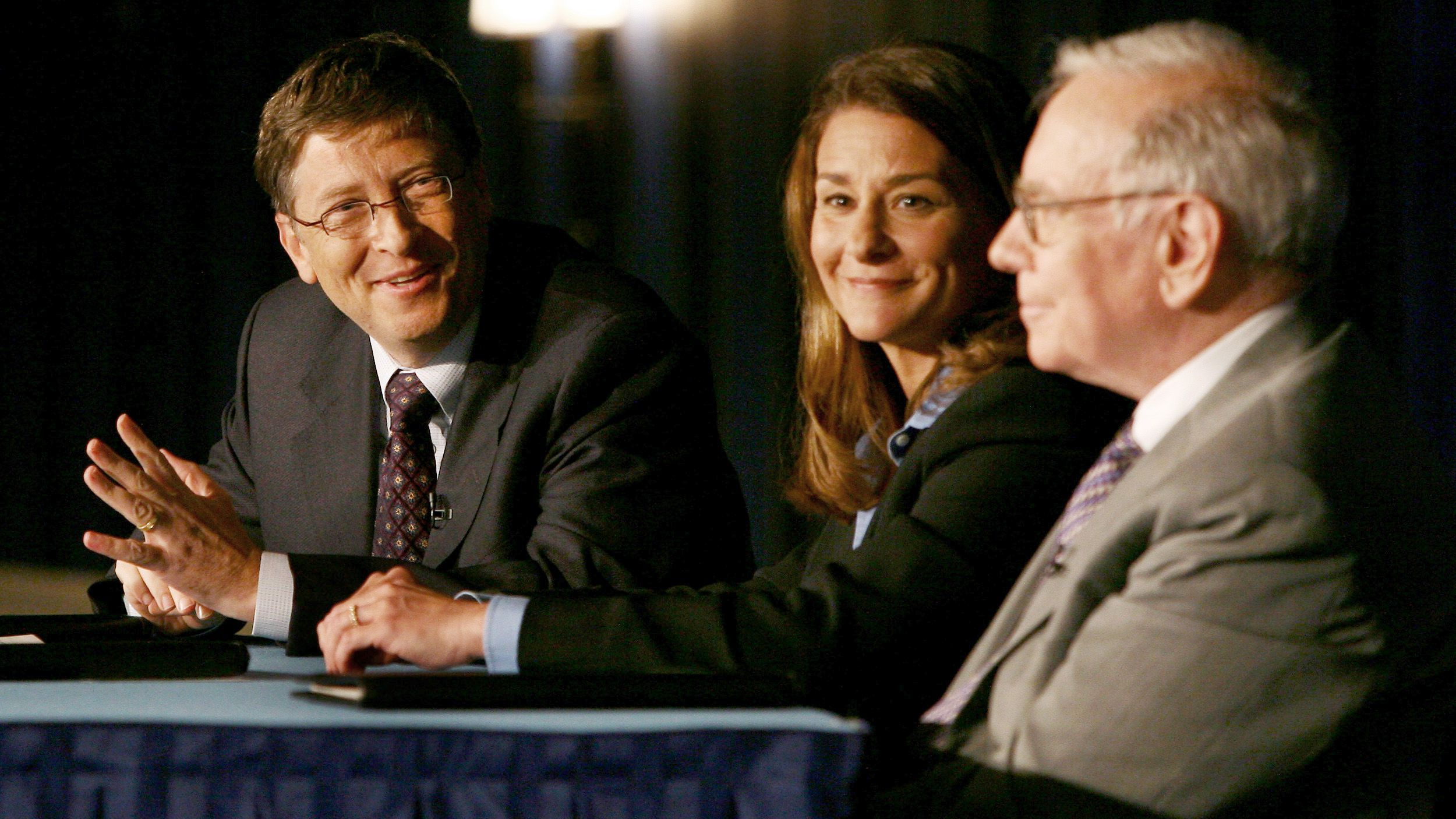 bill gates l speaks as melinda gates and chairman of berkshire hathaway inc