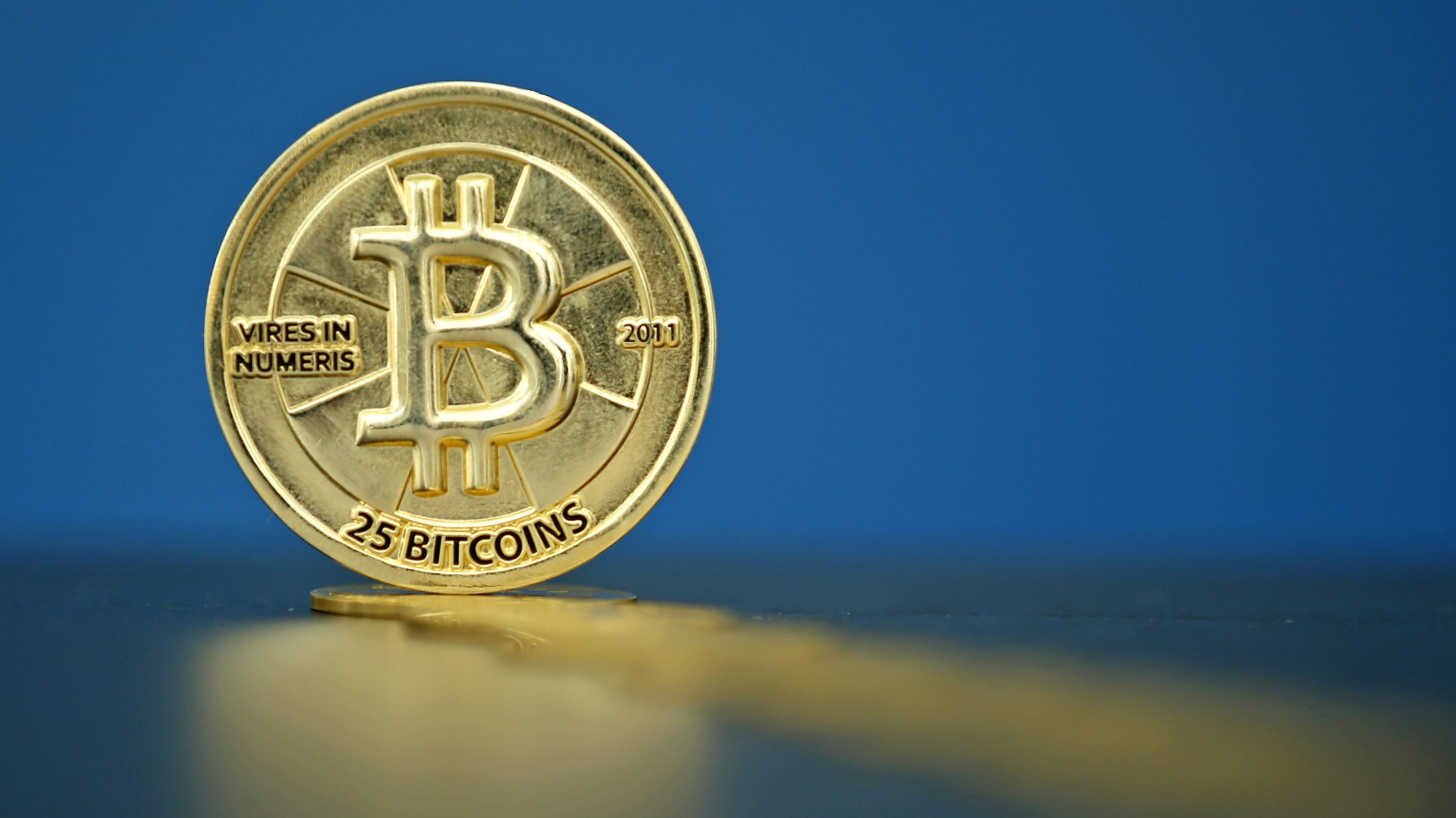 """Bitcoin (virtual currency) coins are seen in an illustration picture taken at La Maison du Bitcoin in Paris, France, May 27, 2015. British authorities have come out in support of digital currencies in the name of promoting financial innovation, while proposing that regulations should be drawn up to prevent their use in crime. But it is technophiles who are leading the drive to make London a real-world hub for trade in web-based """"cryptocurrencies"""", of which bitcoin is the original and still most popular.   Picture taken May 27, 2015."""